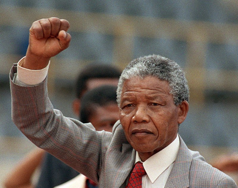 Anti-apartheid leader Nelson Mandela arriving to address a mass rally, a few days after his release from jail, on Feb. 25 1990,  in Bloemfontein, South Africa.