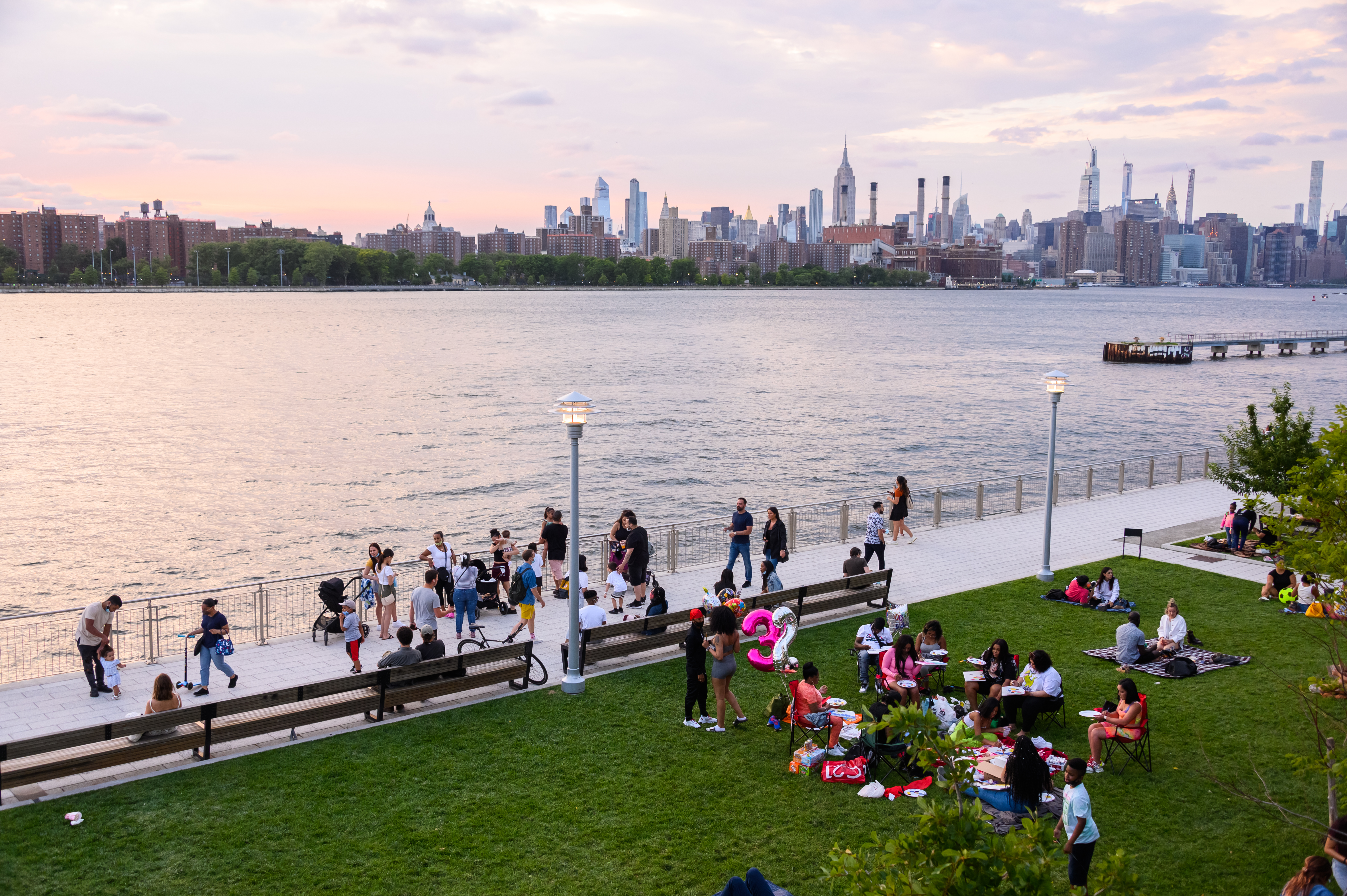 People fill Domino Park in Williamsburg  as New York City moves into Phase 3 of re-opening following restrictions imposed to curb the coronavirus pandemic on July 16, 2020.