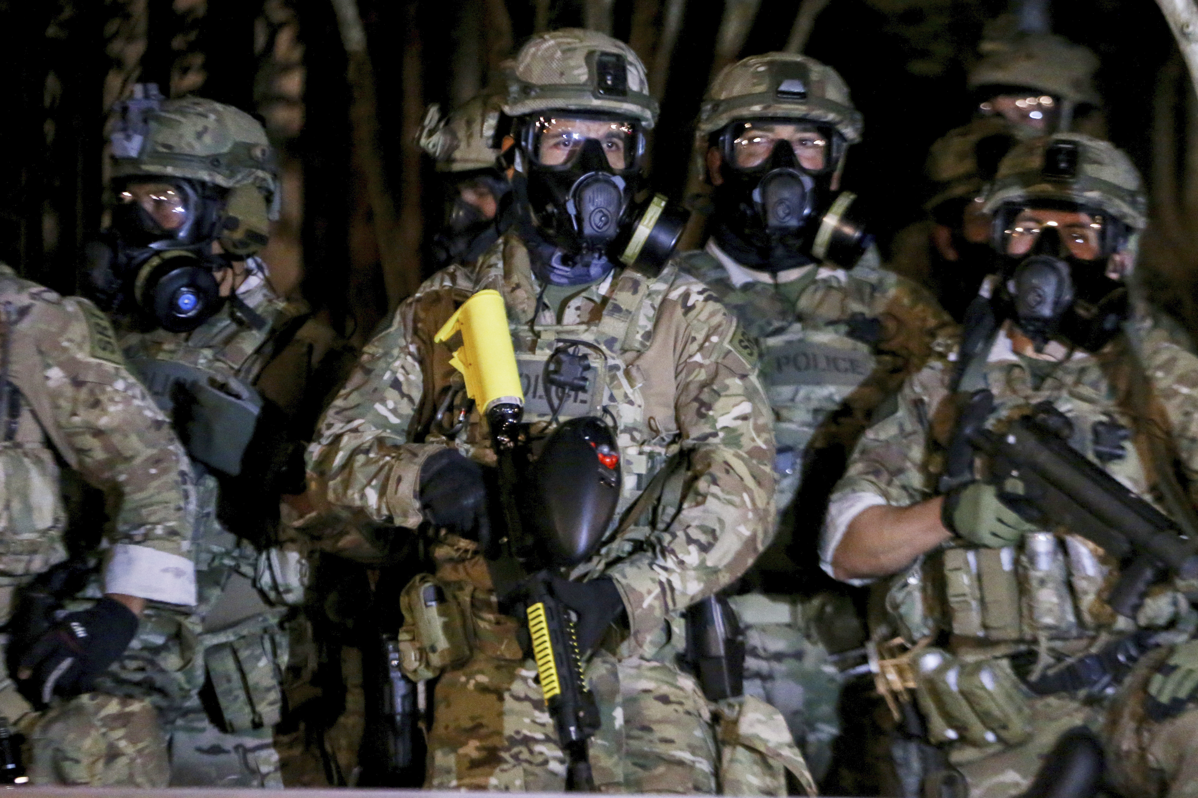 Federal officers deployed tear gas and fired less-lethal rounds into a crowd of protesters late on July 16, 2020 in Portland, Ore.