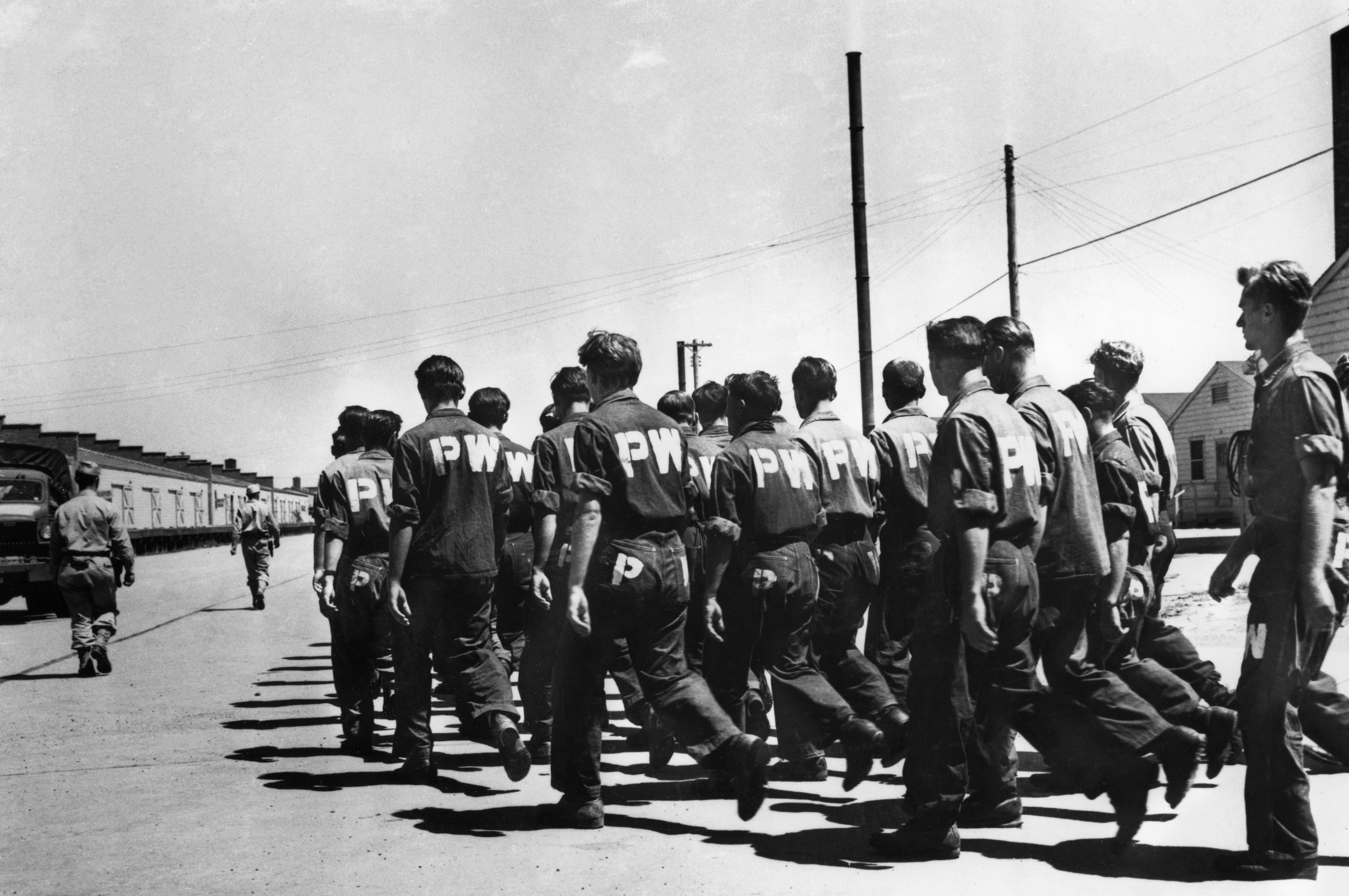 German prisoners at Camp Carson in Colorado sing as they march to the camp laundry in 1943