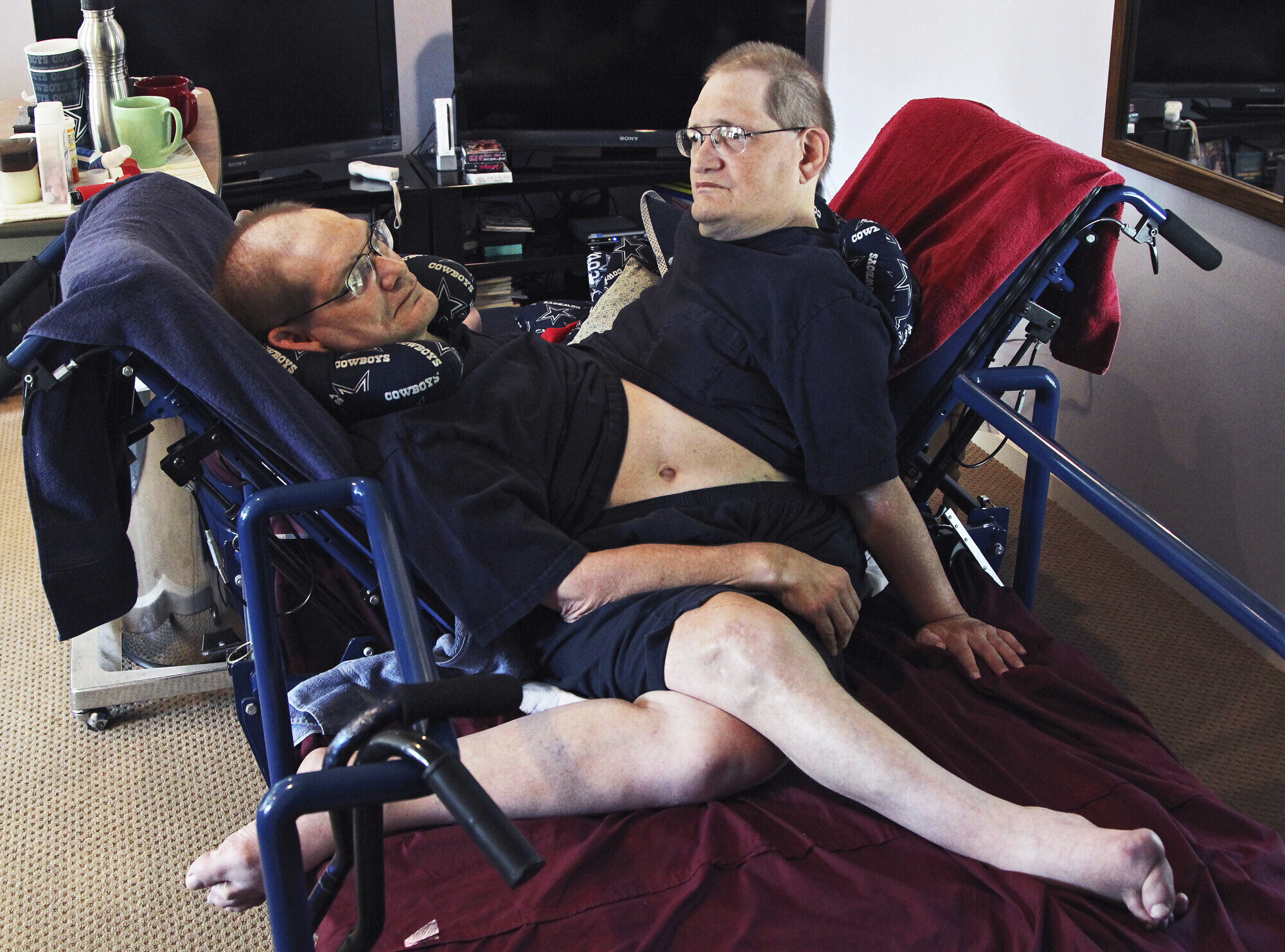Donnie, left, and Ronnie Galyon sit inside their Beavercreek, Ohio, home, in a July 2, 2014 file photo.