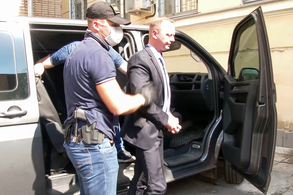 FSB security service officers detain Ivan Safronov (R), Head of Roscosmos Dmitry Rogozin's adviser, suspected of treason against the state. Public Relations Centre of Federal Security Service/TASS on July 7, 2020.