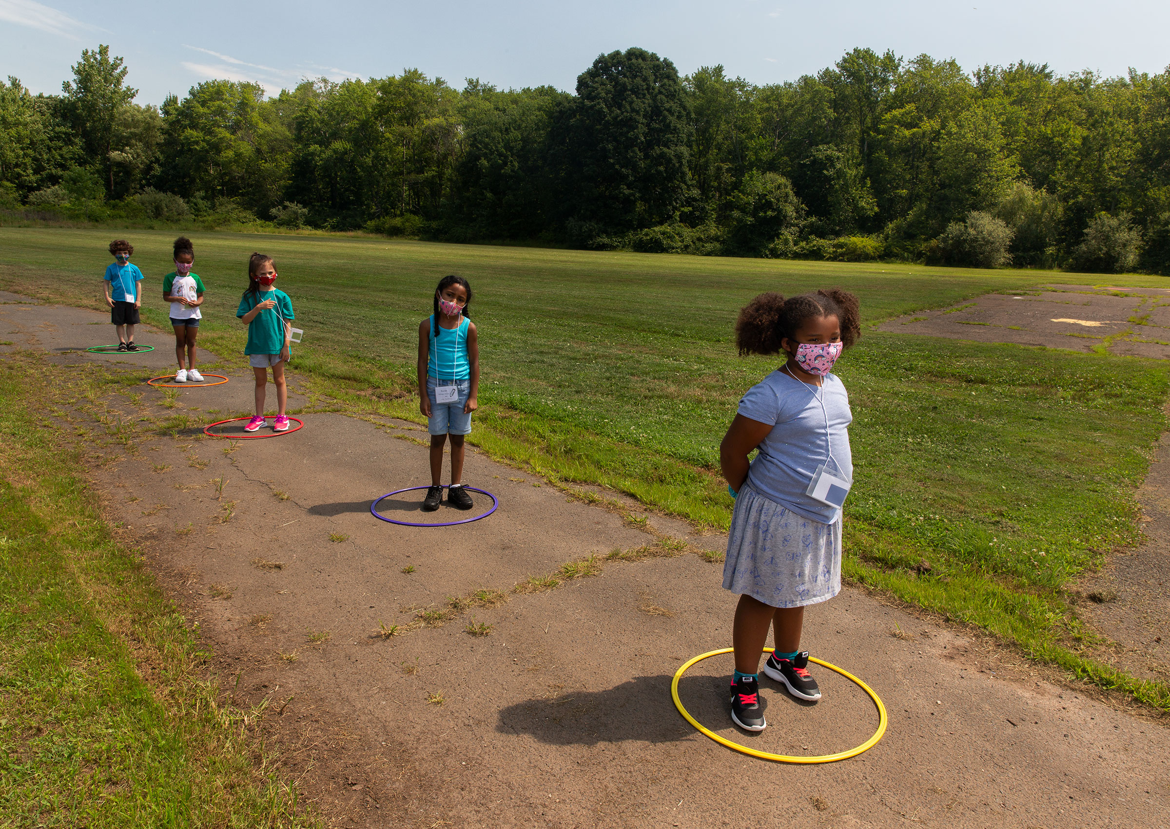 Children line up for school at Wesley Elementary in Middletown, Conn., on July 20