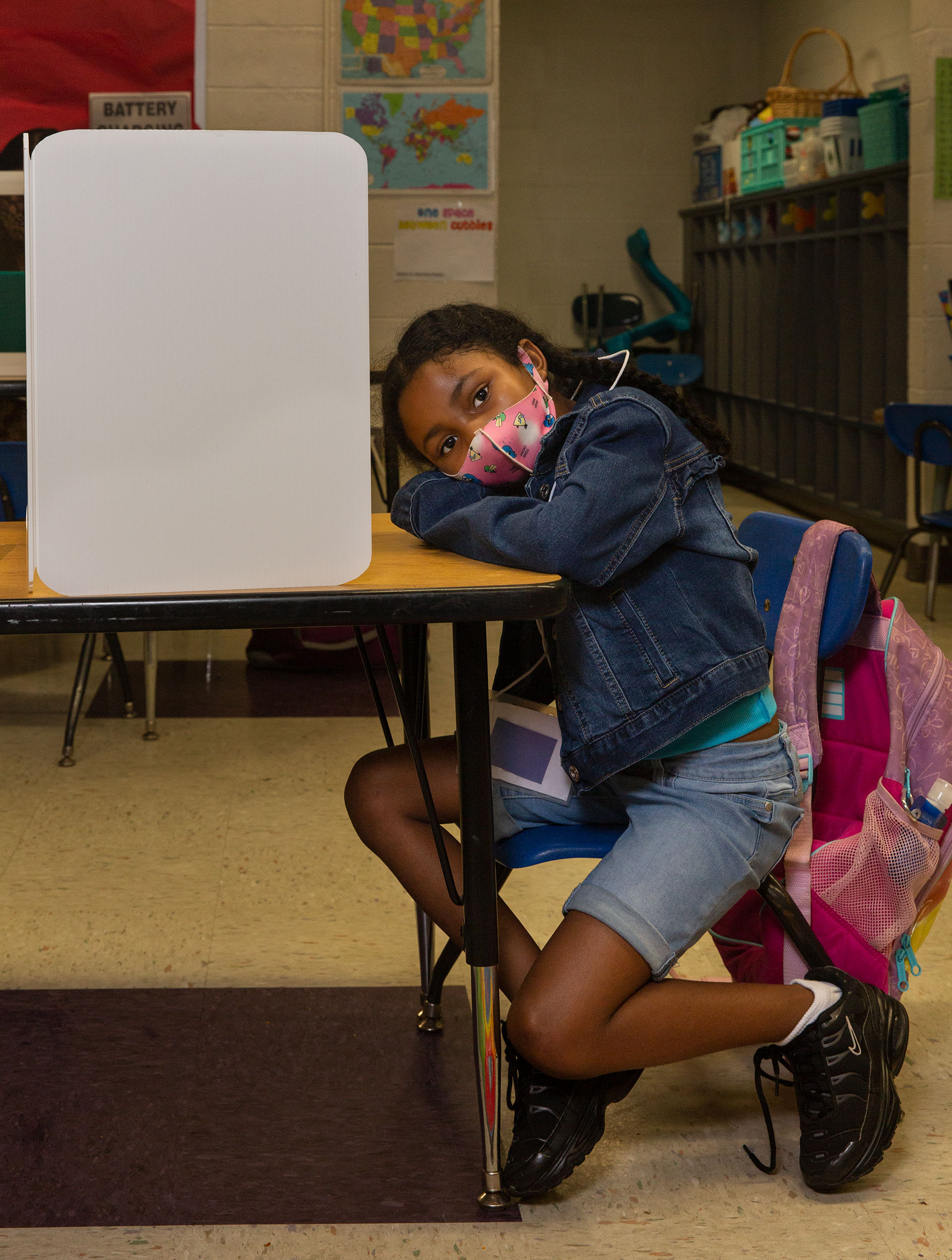 6-year-old Raziah Williams sits at her work station at Wesley Elementary