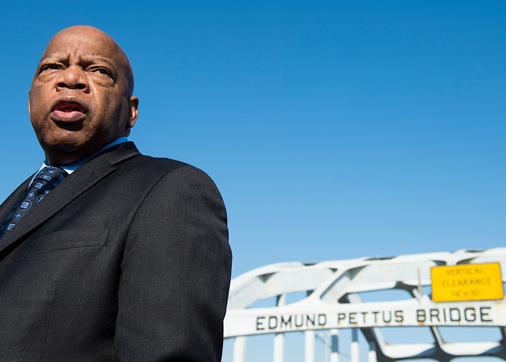 Rep. John Lewis, D-Ga., stands on the Edmund Pettus Bridge in Selma, Ala., in between television interviews on Feb. 14, 2015.