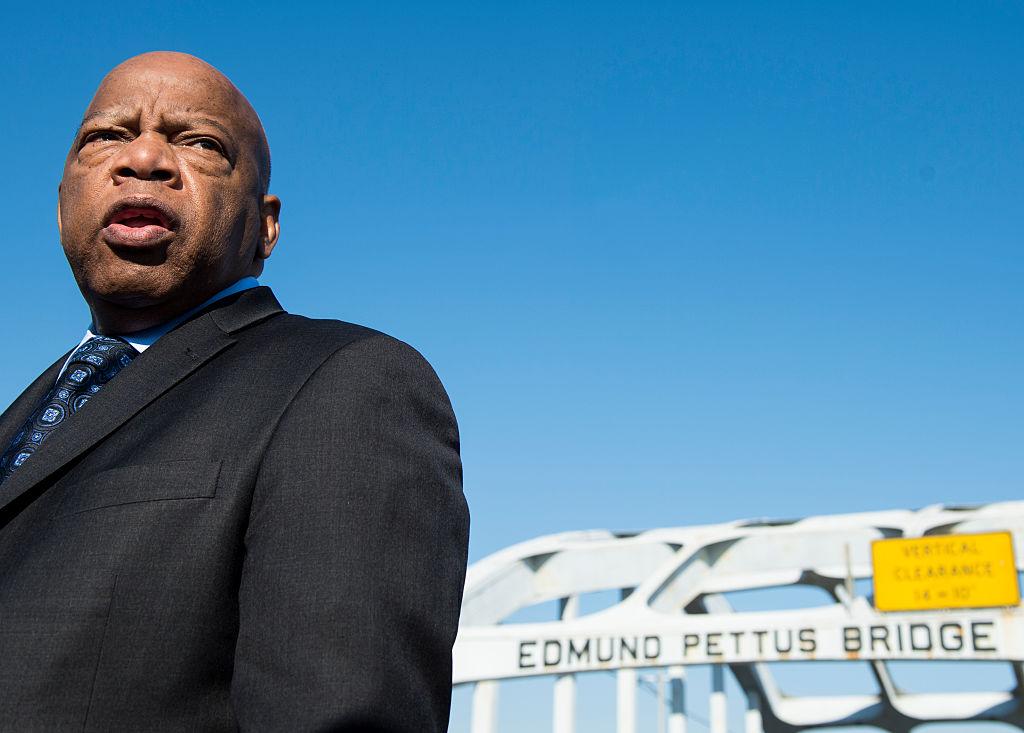 Rep. John Lewis, D-Ga., stands on the Edmund Pettus Bridge in Selma, Ala., in between television interviews on Feb. 14, 2015.