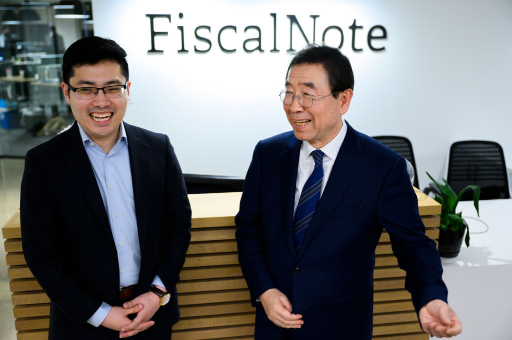 Seoul Mayor Park Won-soon, right, talks with FiscalNote CEO Tim Hwang during a tour of FiscalNote and CQ-Roll Call, Inc via Getty Images offices in Washington on Monday, January 13, 2020.