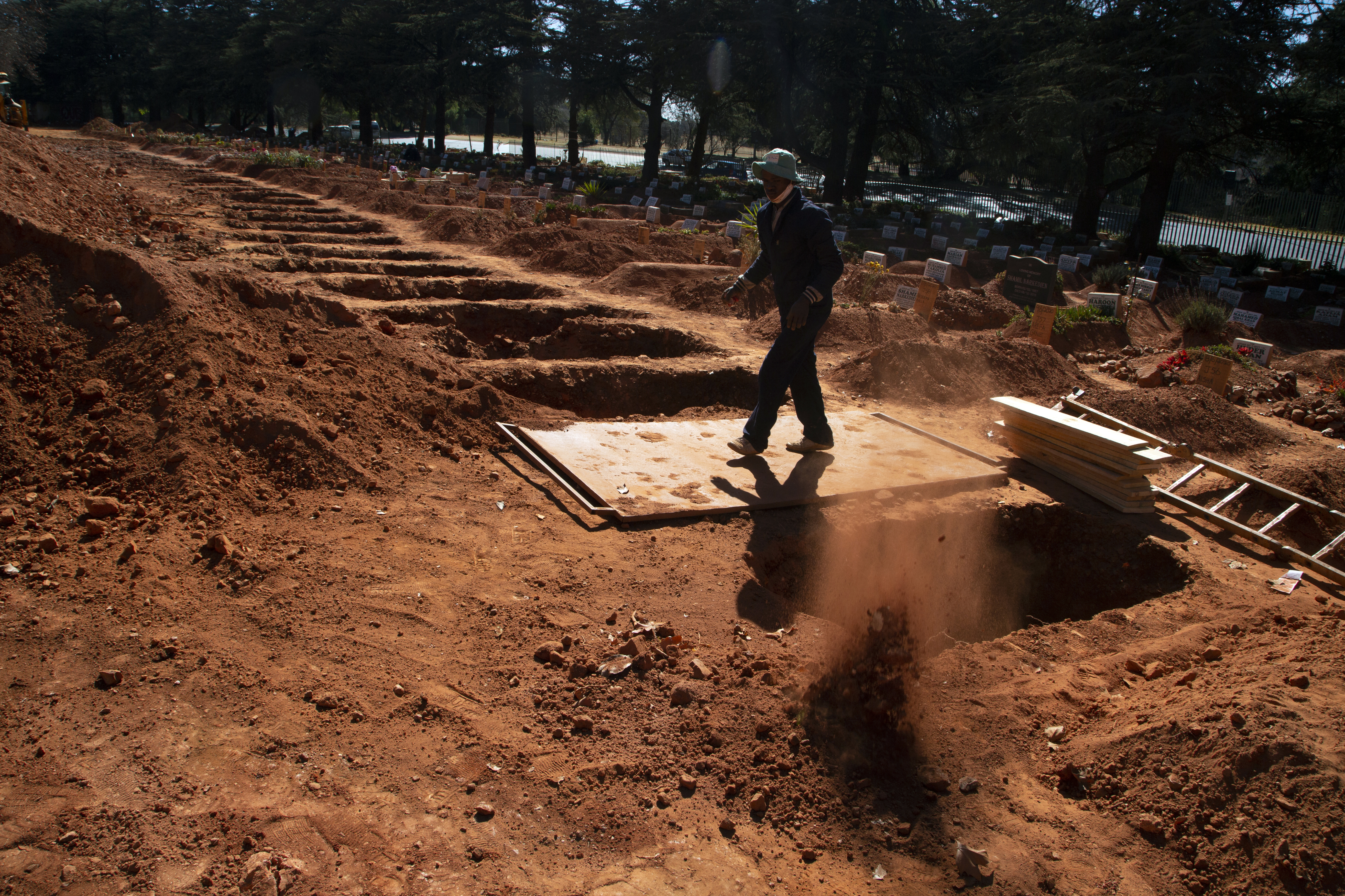 A grave is prepared for a Muslim burial at Johannesburg's main Westpark Cemetery, July 14, 2020.