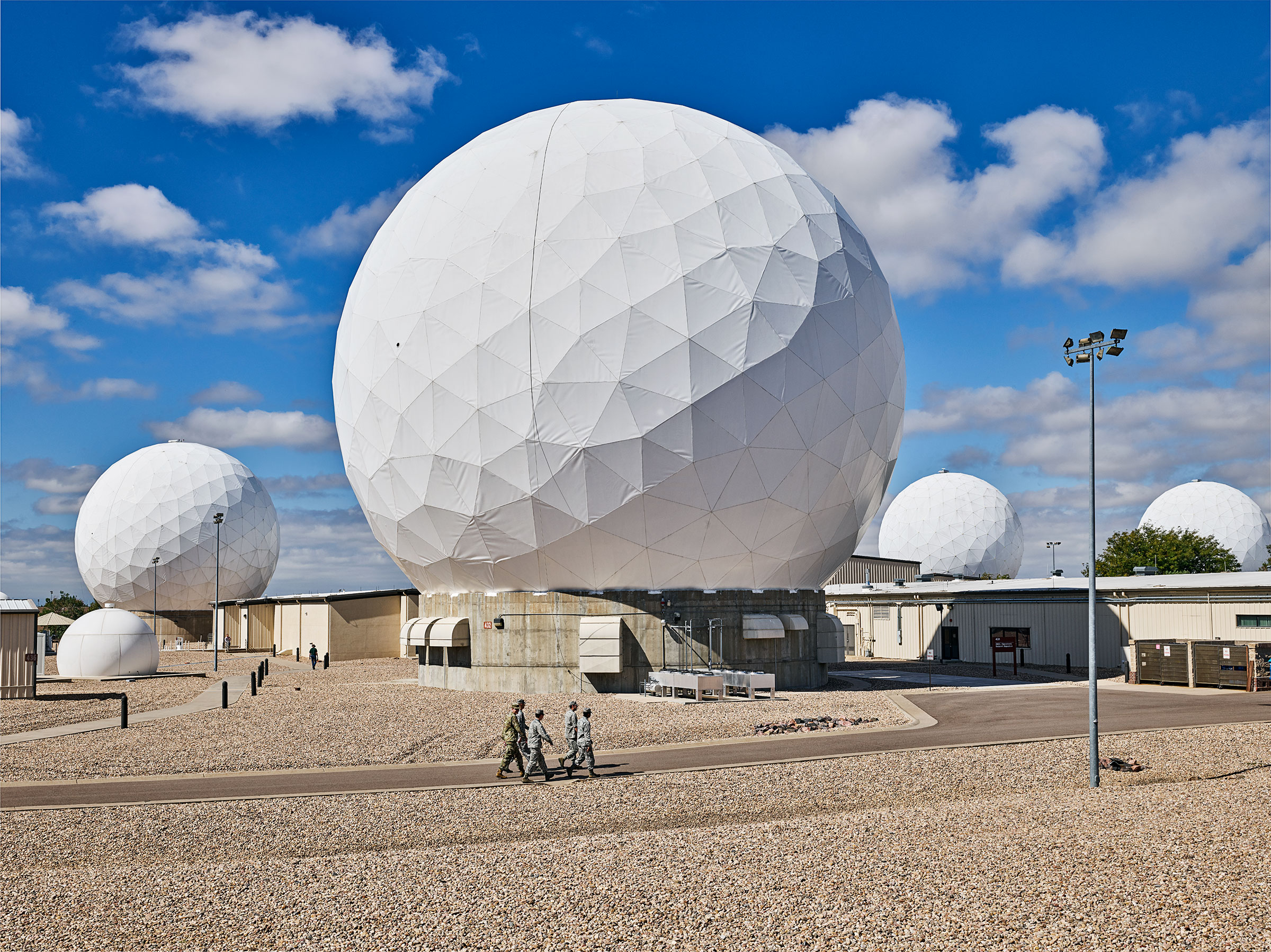 "Radomes, called ""golf balls,"" at Buckley Air Force Base in Colorado protect 60-ft. military satellite dishes."