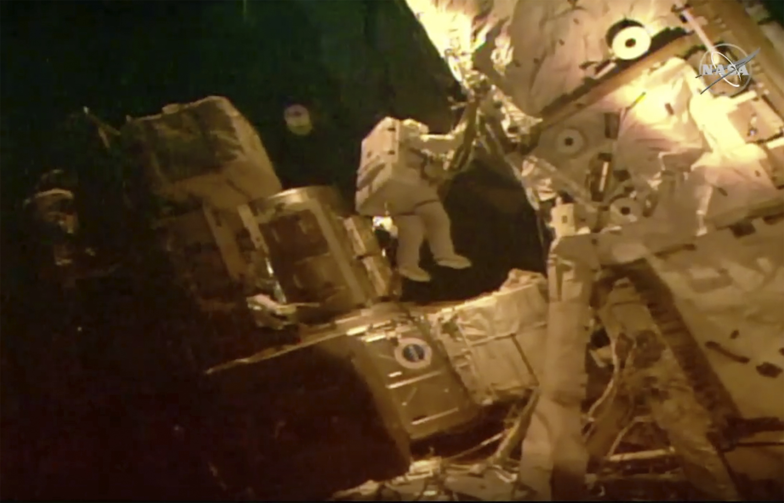 This photo provided by NASA shows astronauts Bob Behnken and Chris Cassidy on a spacewalk outside of the International Space Station on July 21, 2020.