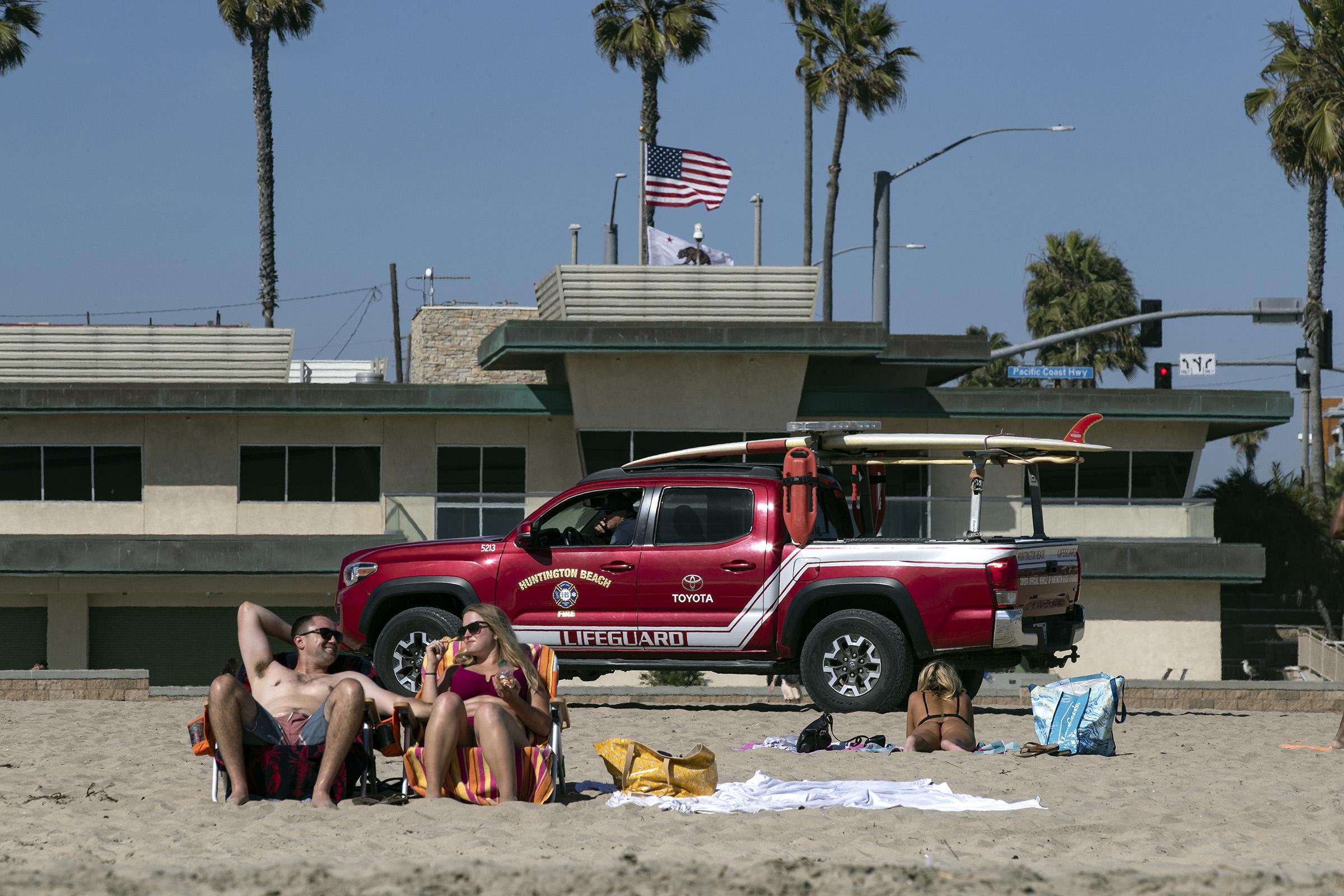 A lifeguard truck patrols the beach as a heatwave hits Southern California amid the coronavirus pandemic, in Huntington Beach, California, on April 24, 2020.