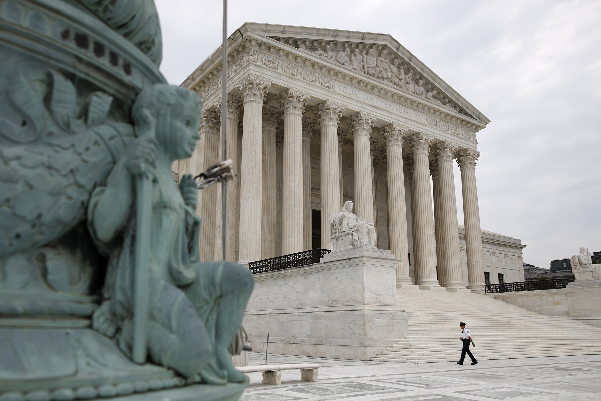 A police officer walks outside the Supreme Court on Capitol Hill in Washington, on July 6, 2020.
