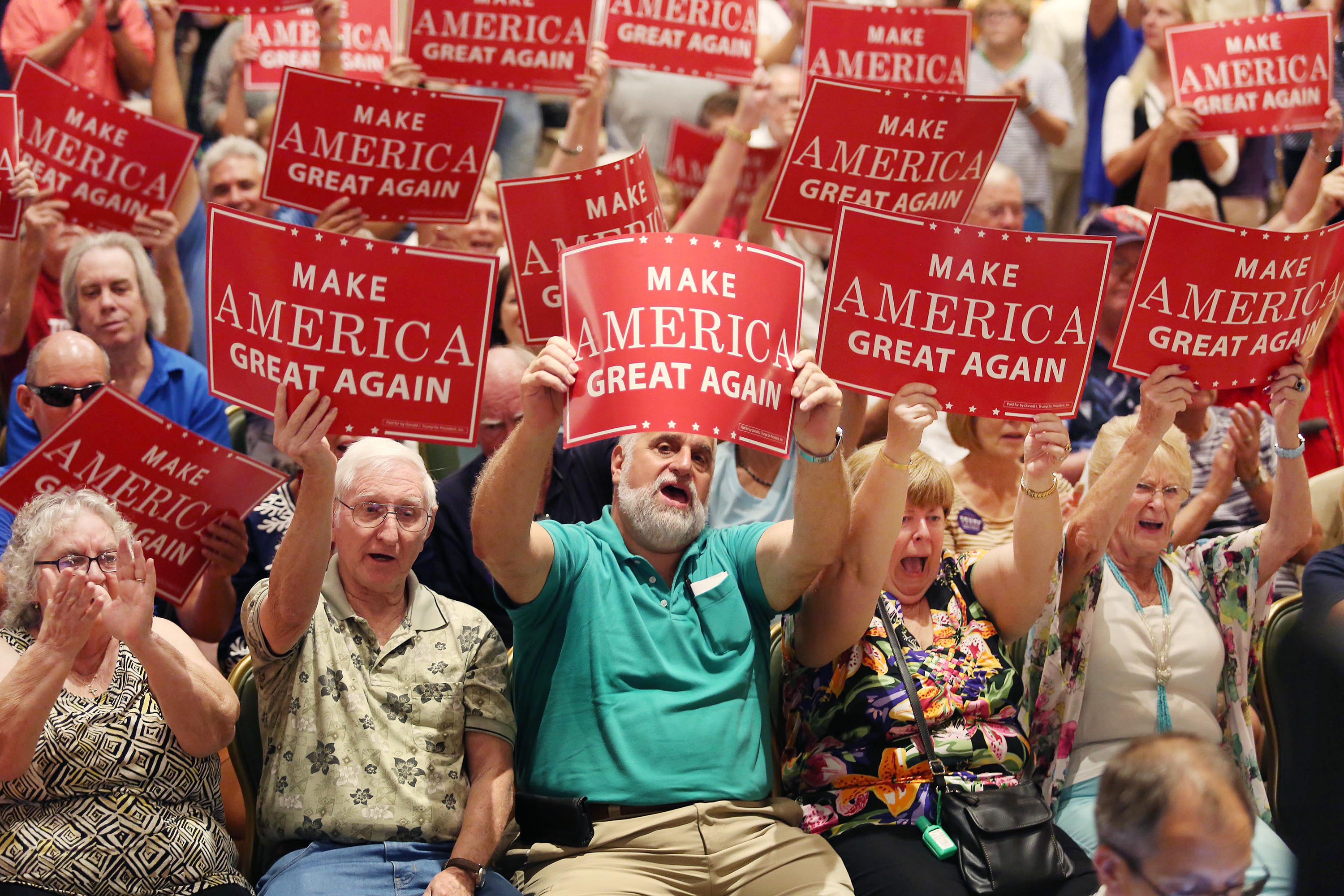 Supporters cheer as then-Republican vice presidential candidate Mike Pence speaks at a campaign rally at The Villages, Fla., on Saturday, Sept. 17, 2016.