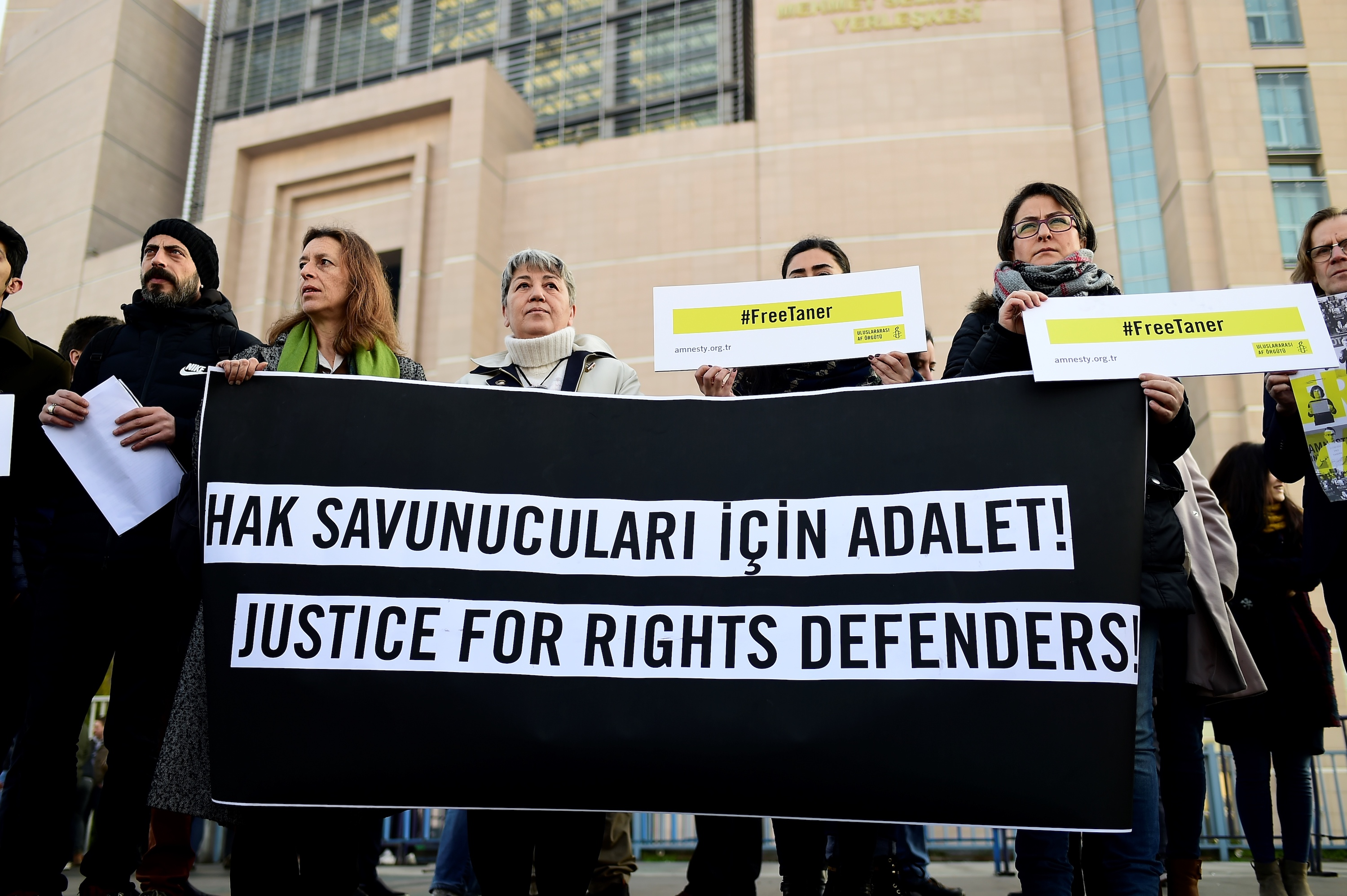 A group of human rights activists gather outside the Caglayan courthouse in Istanbul on January 31, 2018 as the trial of eleven human rights activists resumes, including the two top figures with Amnesty International in Turkey and two foreigners, on terror charges in a case that has sparked international alarm.