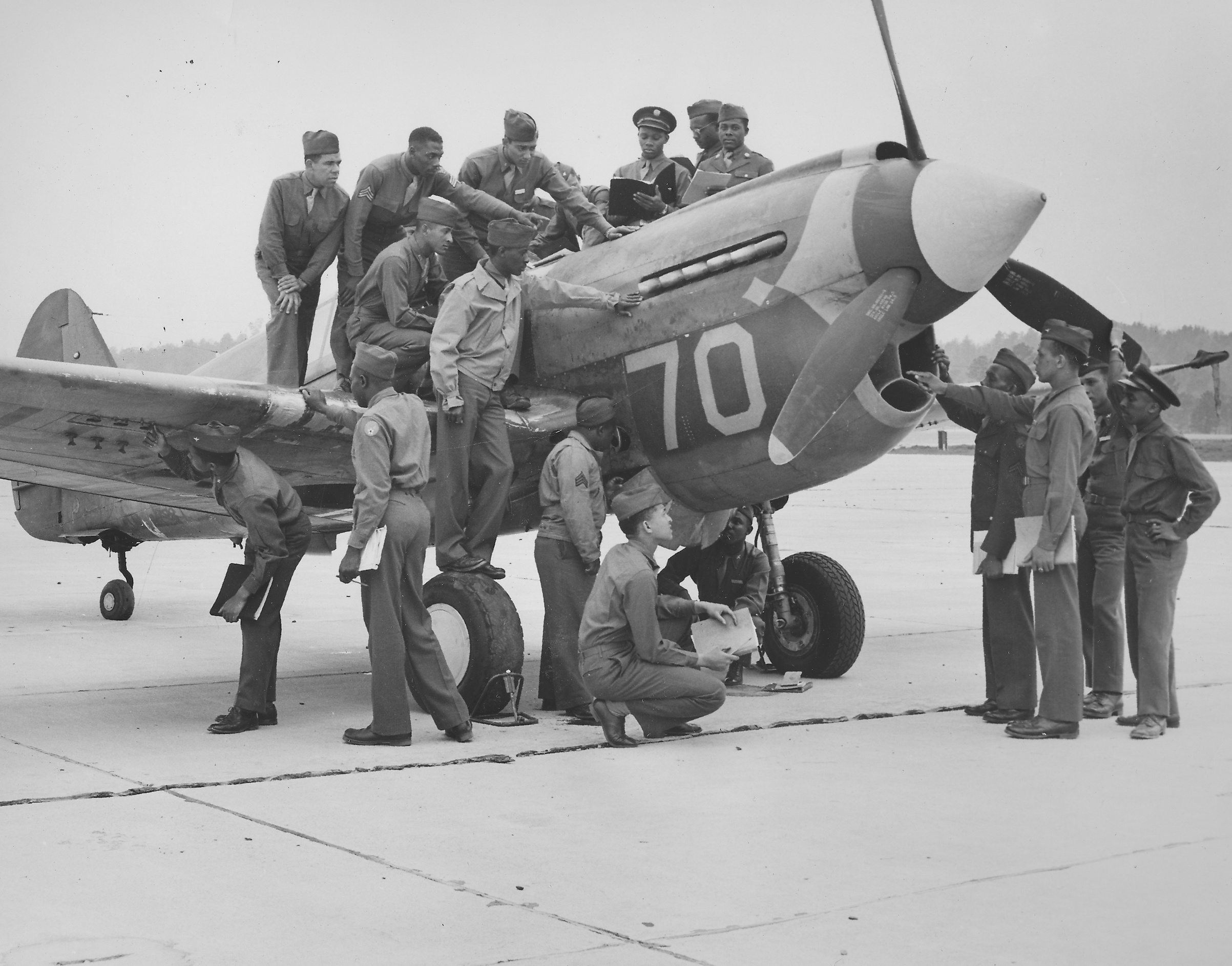 Tuskegee Airmen, with fighter airplane, at Tuskegee Army Flying School during World War II, Tuskegee, Ala., 1944.