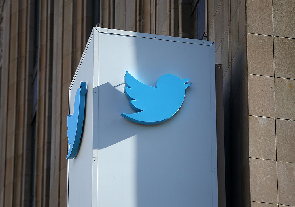 A sign with the Twitter logo is seen outside of the company's headquarters in San Francisco, Calif. on Oct. 25, 2013.