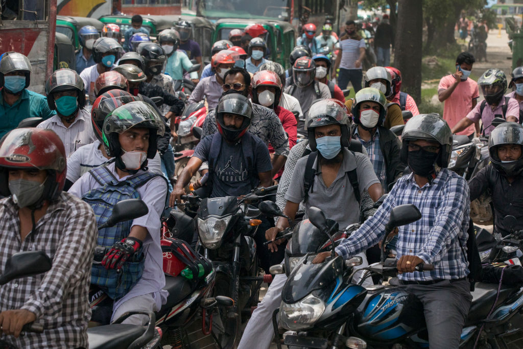 Motorbike drivers waiting in a traffic jam wear face masks as a preventive measure against the spread of coronavirus in Dhaka, Bangladesh on June 25, 2020.