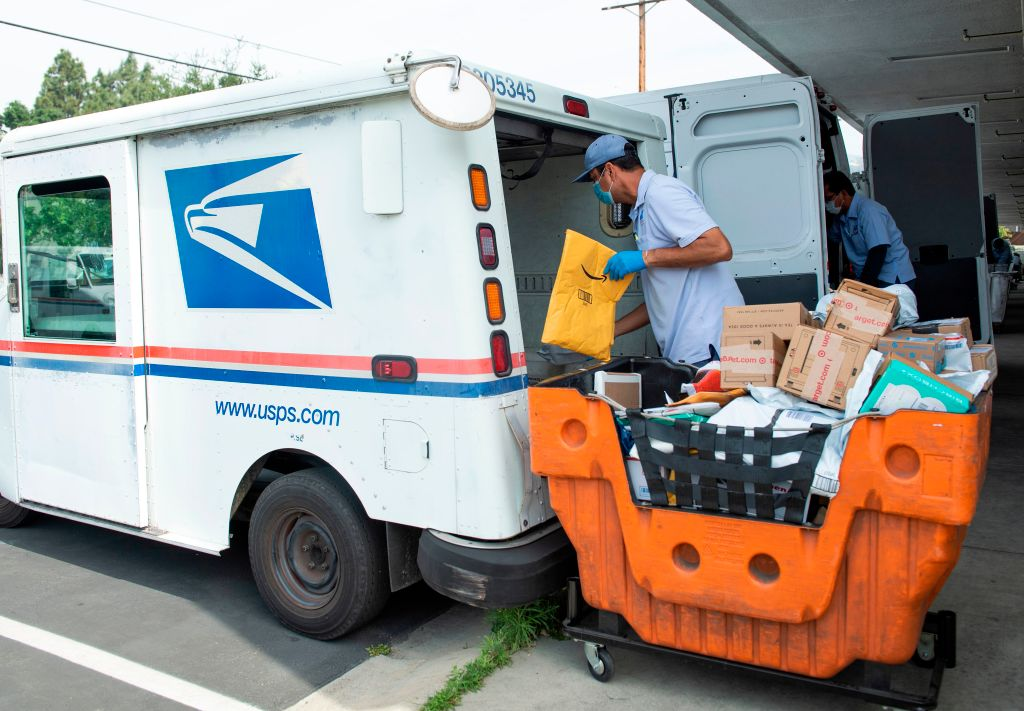 A mail carrier delivers mail amid the Covid 19 pandemic in in Los Feliz, Calif. on April 29, 2020.