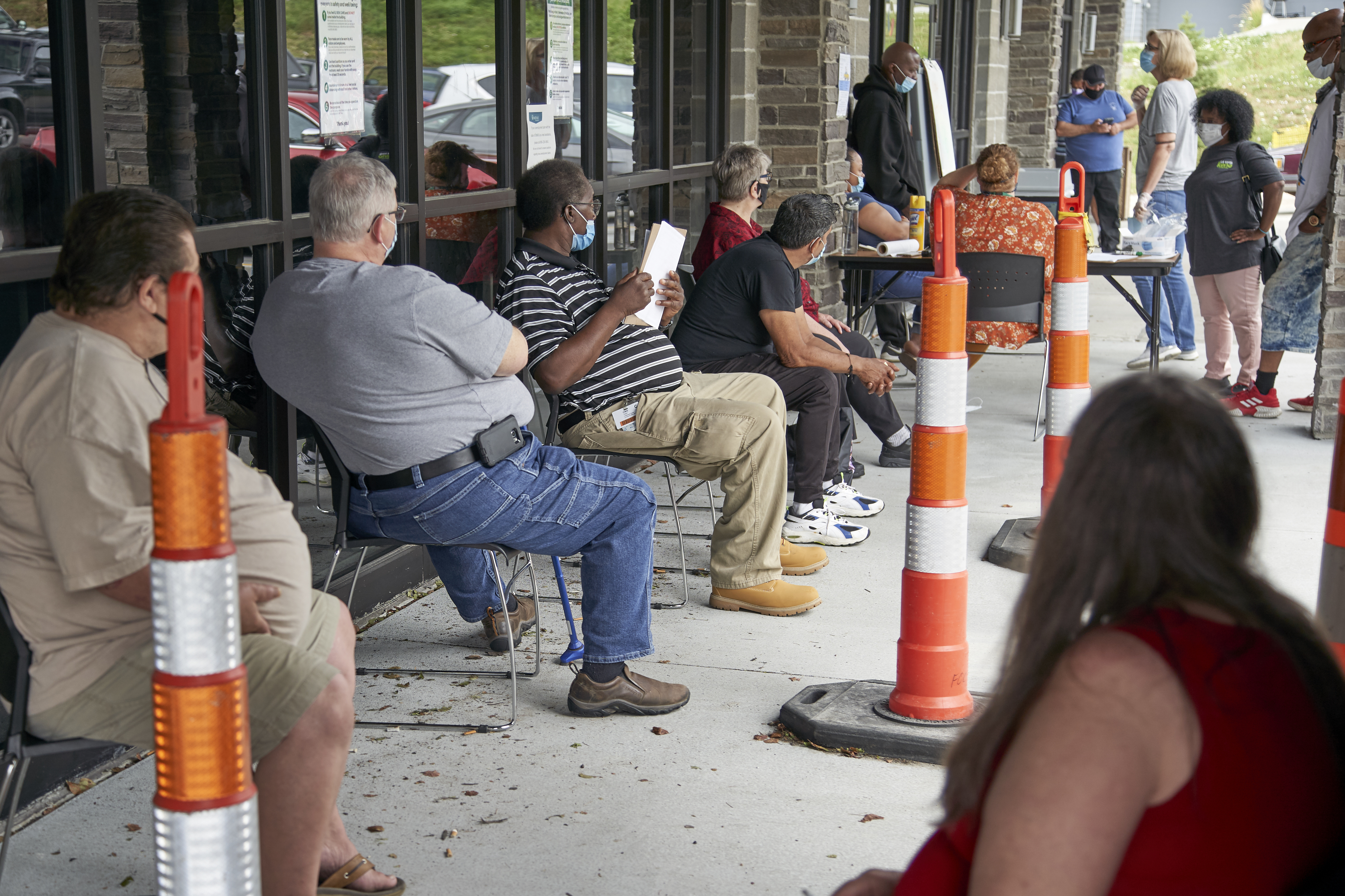 Job seekers exercise social distancing as they wait to be called into the Heartland Workforce Solutions office in Omaha, Neb., July 15, 2020.