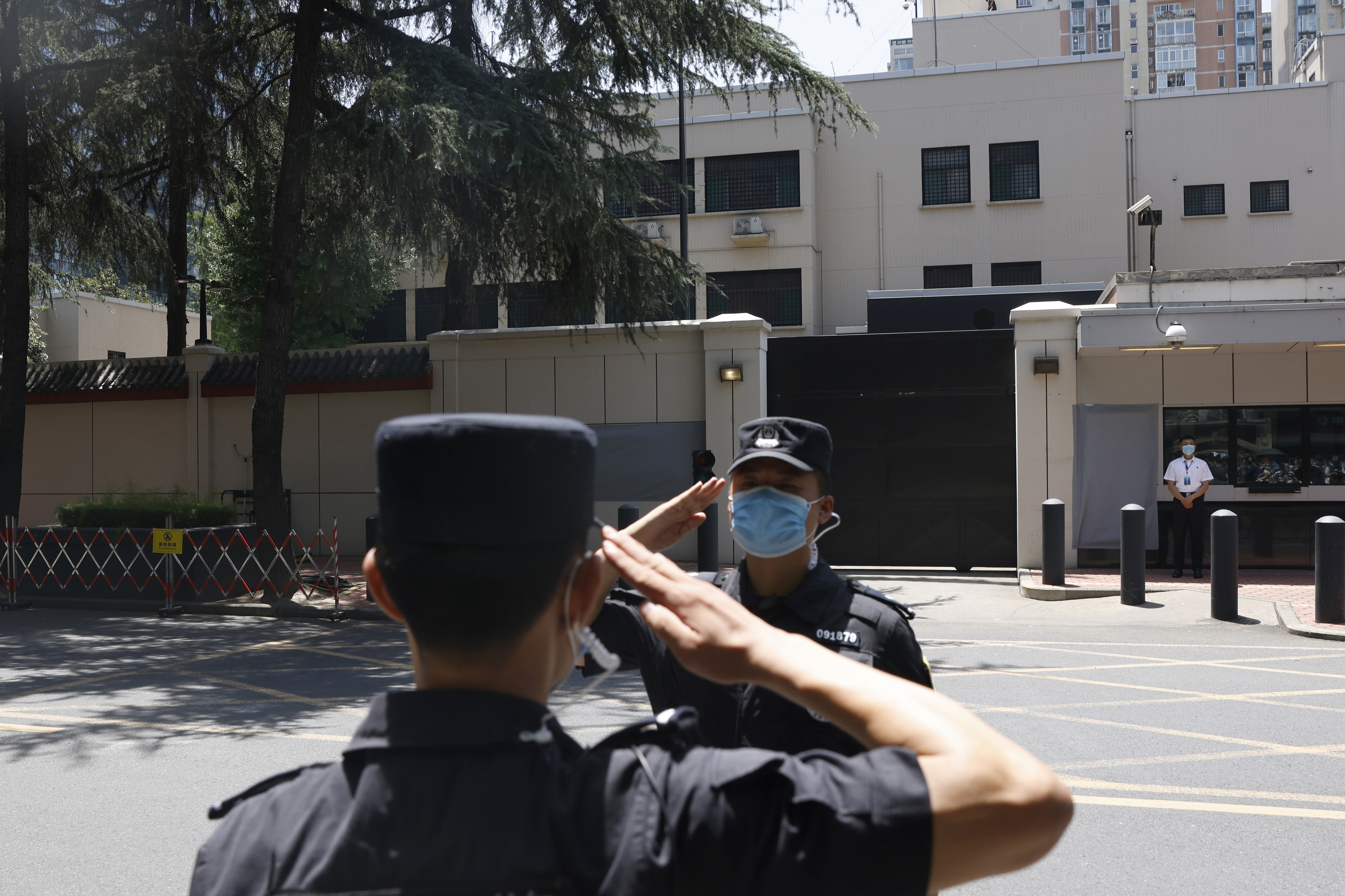 Chinese SWAT officers salute each other at the former United States Consulate in Chengdu in southwest China's Sichuan province on Monday, July 27, 2020. Chinese authorities took control of the former U.S. consulate in the southwestern Chinese city on Monday after it was ordered closed amid rising tensions between the global powers.