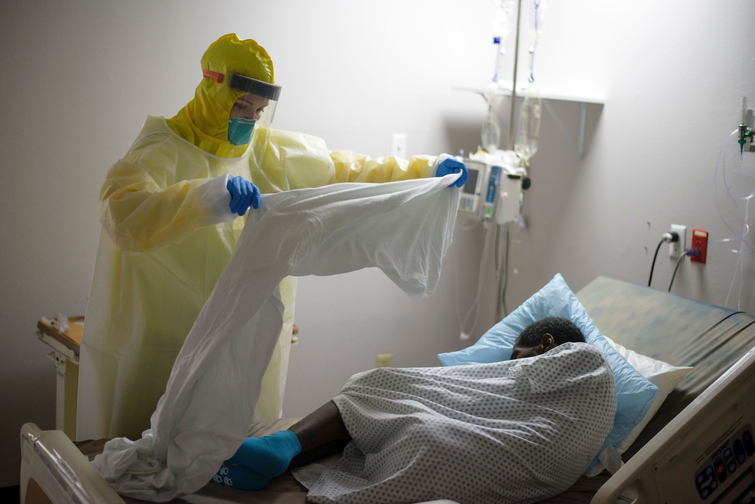 A healthcare worker tends to a patient in the Covid-19 Unit at United Memorial Medical Center in Houston, Texas, on July 2, 2020.