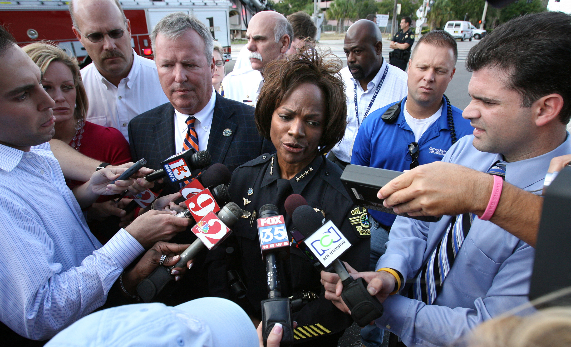 Demings at the scene of a mass shooting in Orlando's Gateway Center in 2009
