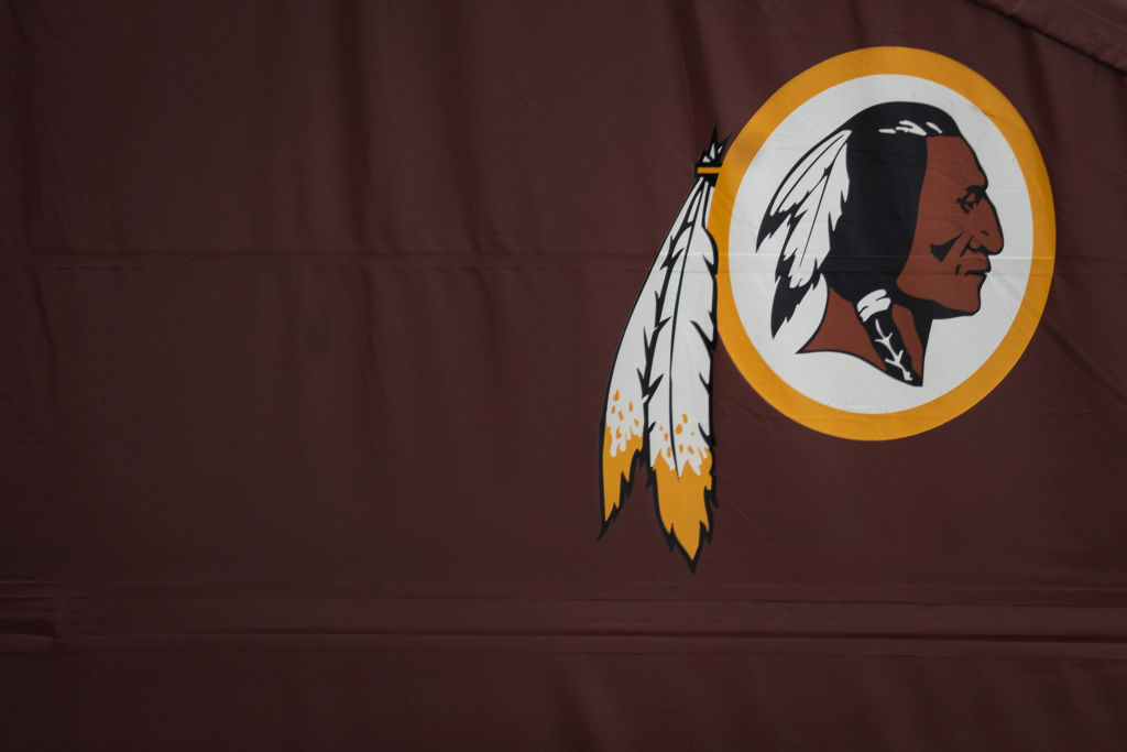 A Washington Redskins logo is seen on the outside of FedEx Field on July 7, 2020 in Landover, Maryland.
