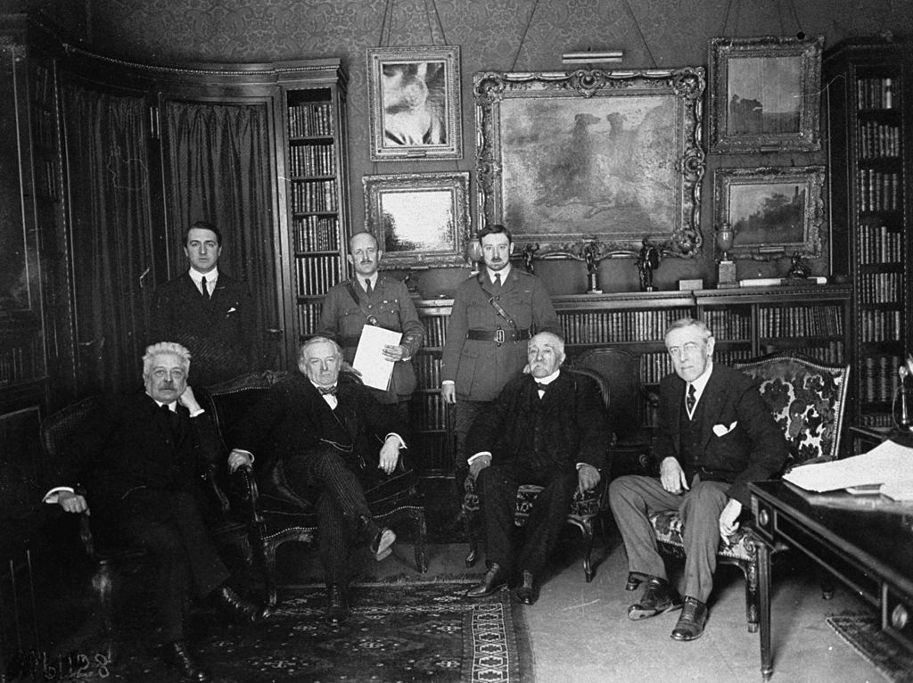 1919 Peace Conference attendees (seated, L-R) Italian Premier Vittorio Orlando, British Prime Minister David Lloyd George, French Premier Georges Clemenceau, U.S. President Woodrow Wilson meeting in Paris prior to the signing of the Versailles Treaty.