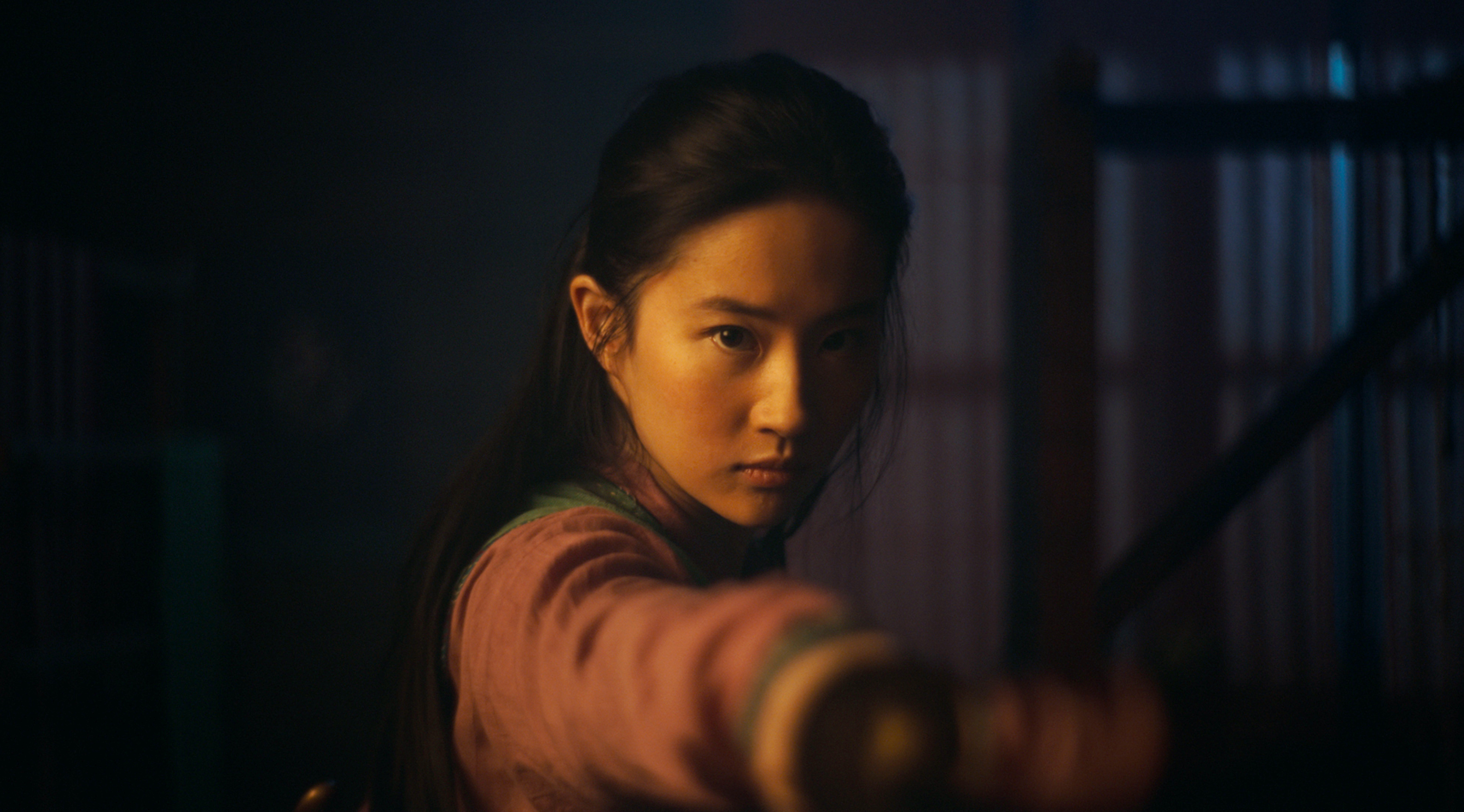 This image released by Disney shows Yifei Liu in the title role of  Mulan.