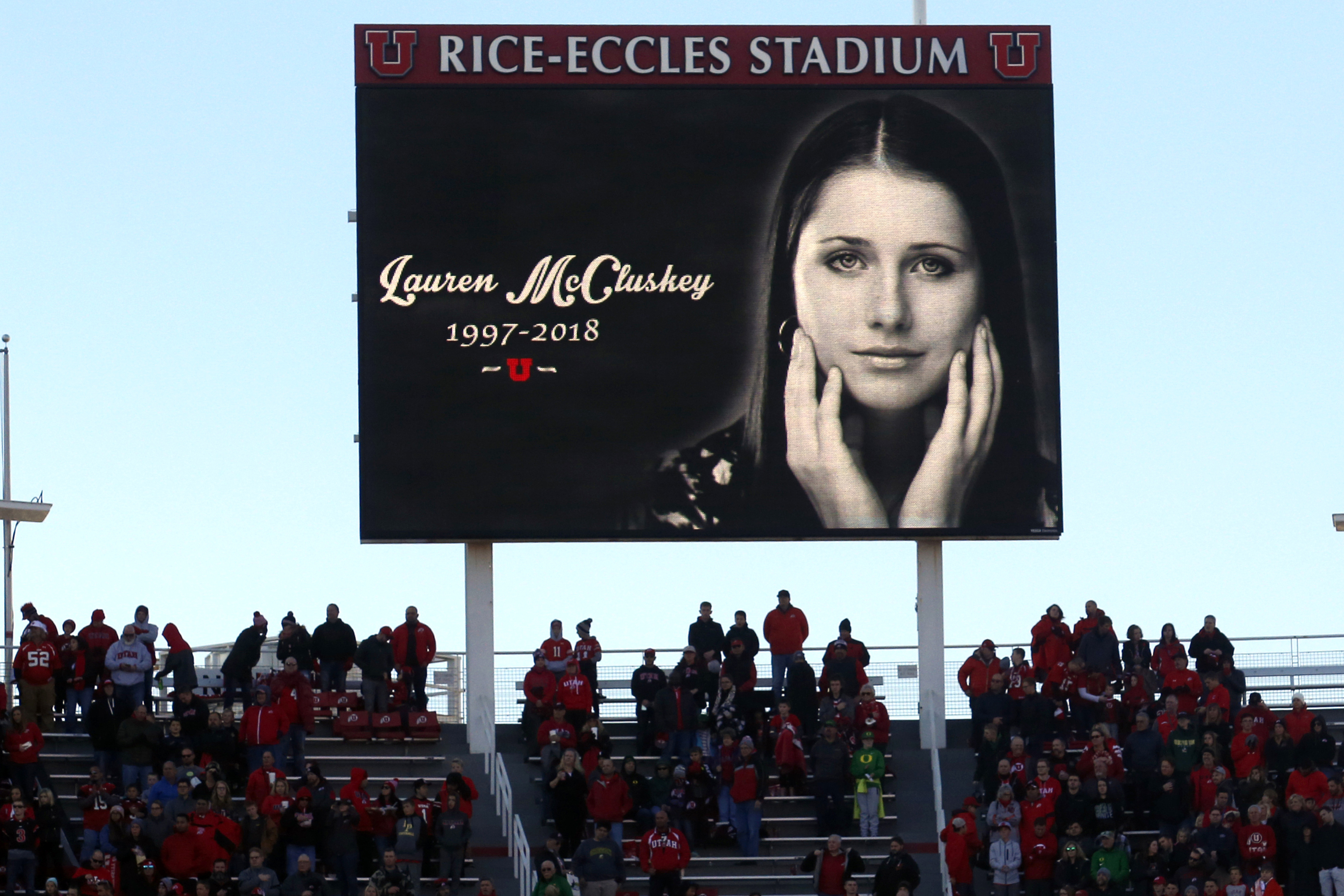 A photograph of University of Utah student and track athlete Lauren McCluskey, who was fatally shot on campus, is projected on the video board before the start of an NCAA college football game between Oregon and Utah in Salt Lake City, on Nov. 10, 2018.