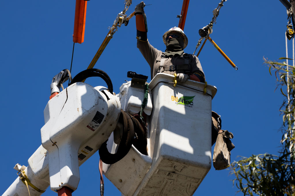 A Southern California Edison crew installs a new overhead switch for circuit reliability on May 13, 2020 in Ventura, Calif.