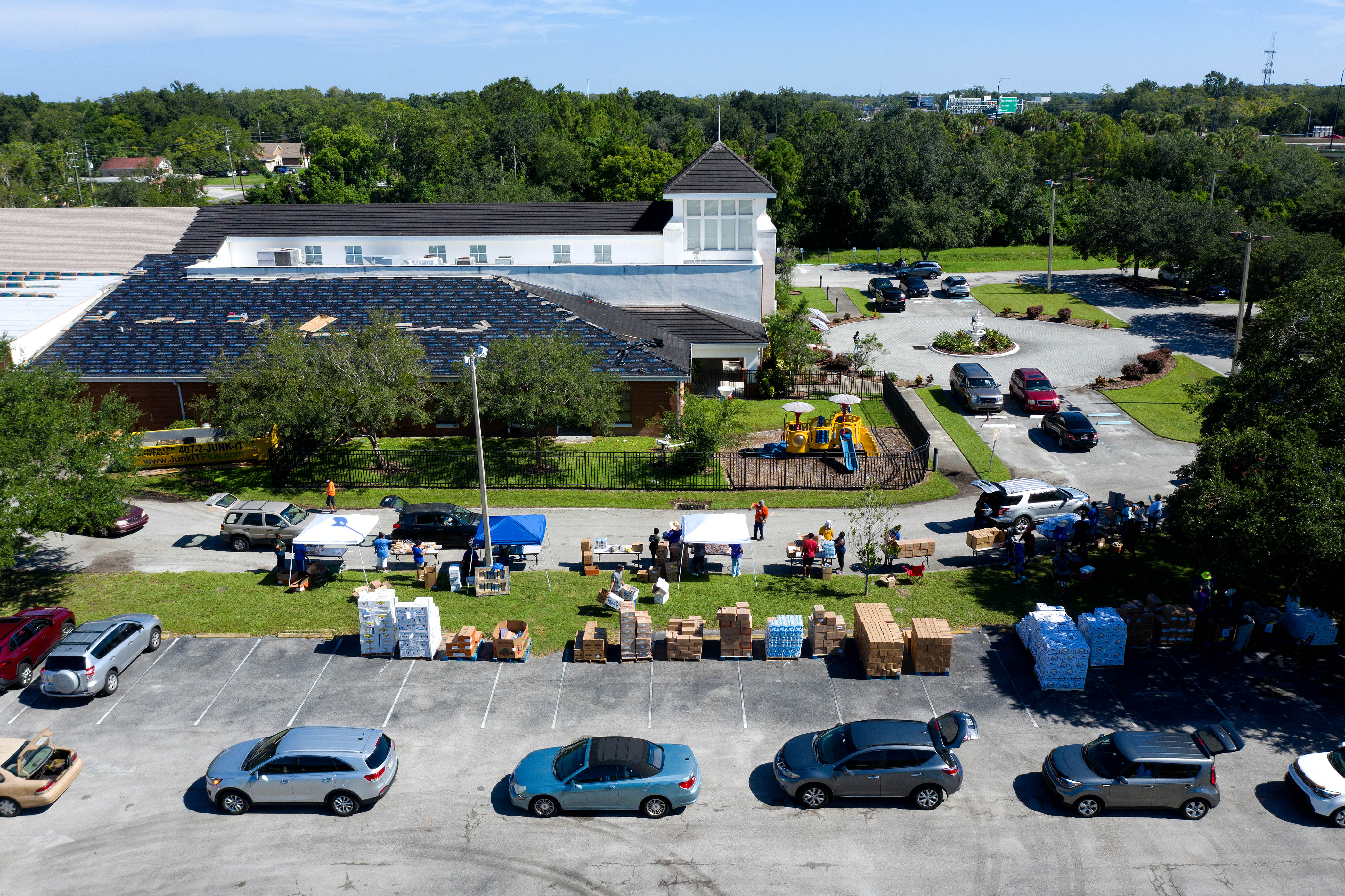 Cars line up to receive food from the Second Harvest Food Bank of Central Florida at Carter Tabernacle Christian Methodist Episcopal Church on Aug. 8, 2020 in Orlando.