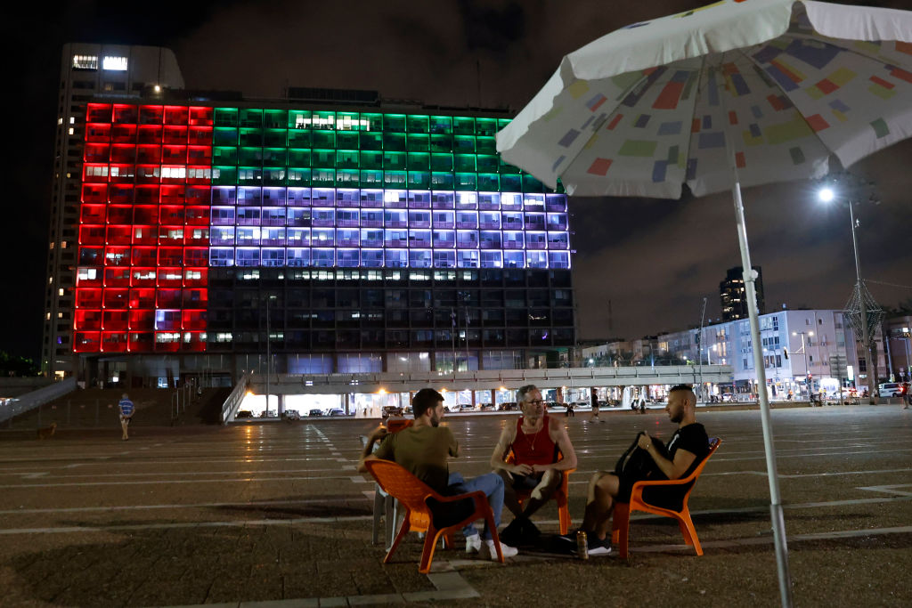 The city hall in the Israeli city of Tel Aviv is lit up in the colors of the United Arab Emirates national flag on August 13, 2020.