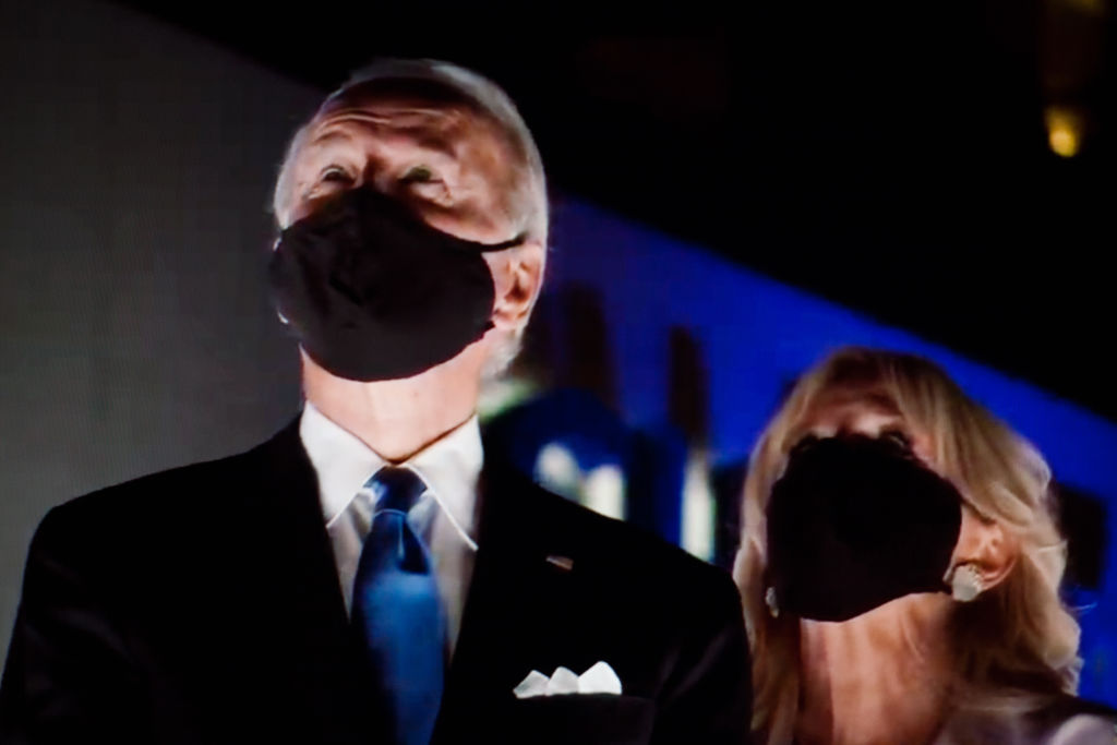 Presidential nominee and former US Vice President Joe Biden and wife Jill Biden wear face masks to watch a fireworks display during the closing moments of the virtual 2020 Democratic National Convention.