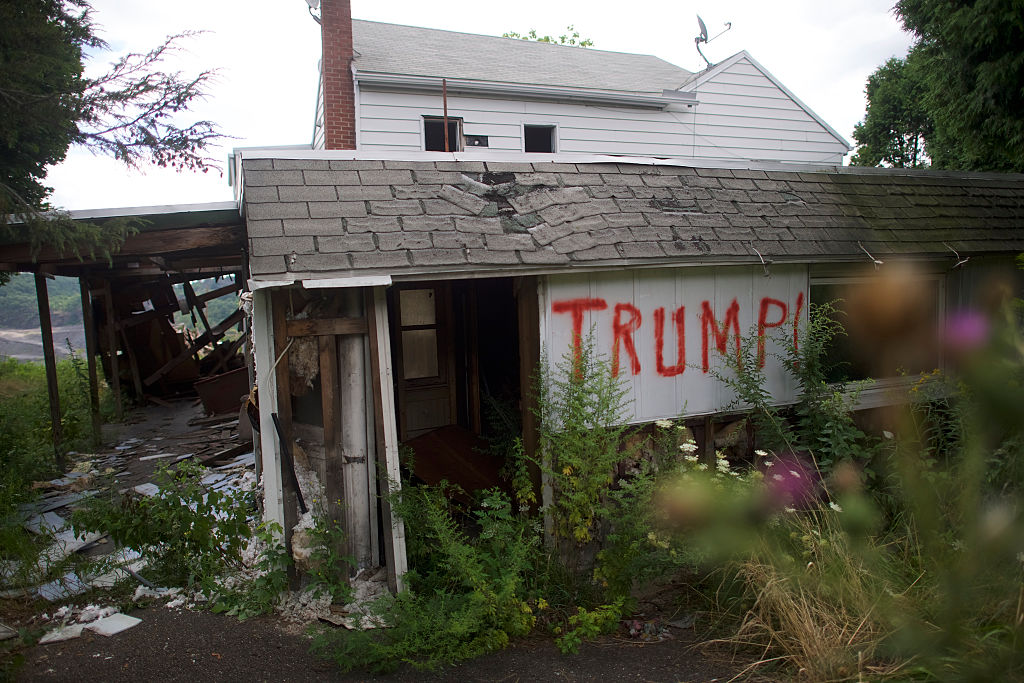 An abandoned house is spray painted  Trump!  on August 14, 2016 in Schuylkill County, Pennsylvania. This Northeastern Pennsylvania region has a rich coal mining history, but the majority of nearby coal mines have closed.