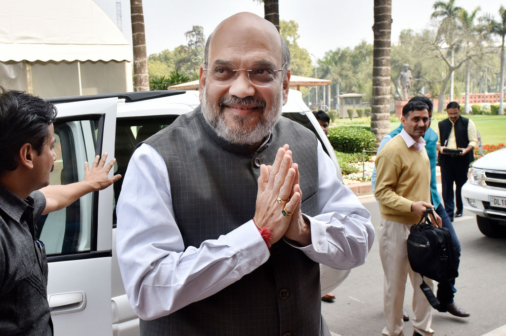 Home Minister Amit Shah gestures upon his arrival to attend the ongoing Budget session at Parliament on March 12, 2020 in New Delhi, India.