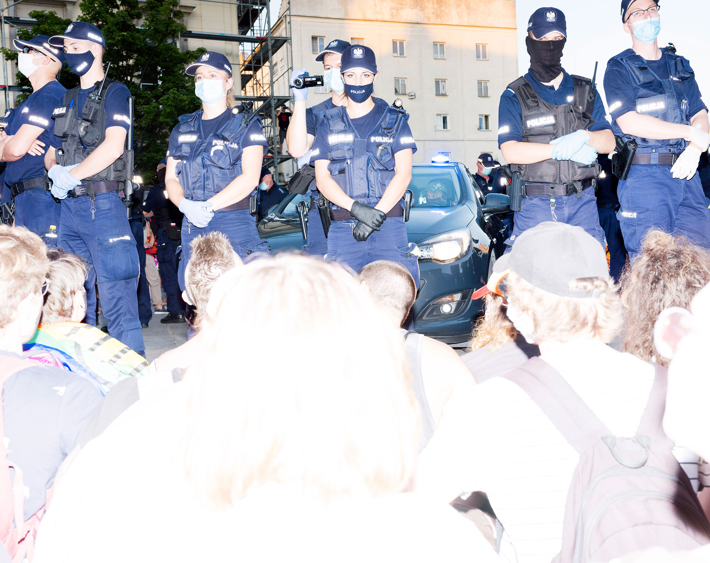 Protestors sit in front of police on in Warsaw, Poland Aug. 7, 2020.