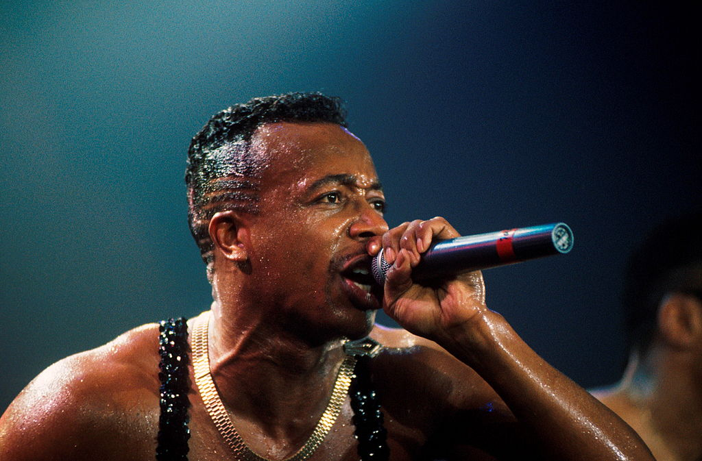 MC Hammer performs on stage in London, 1990.