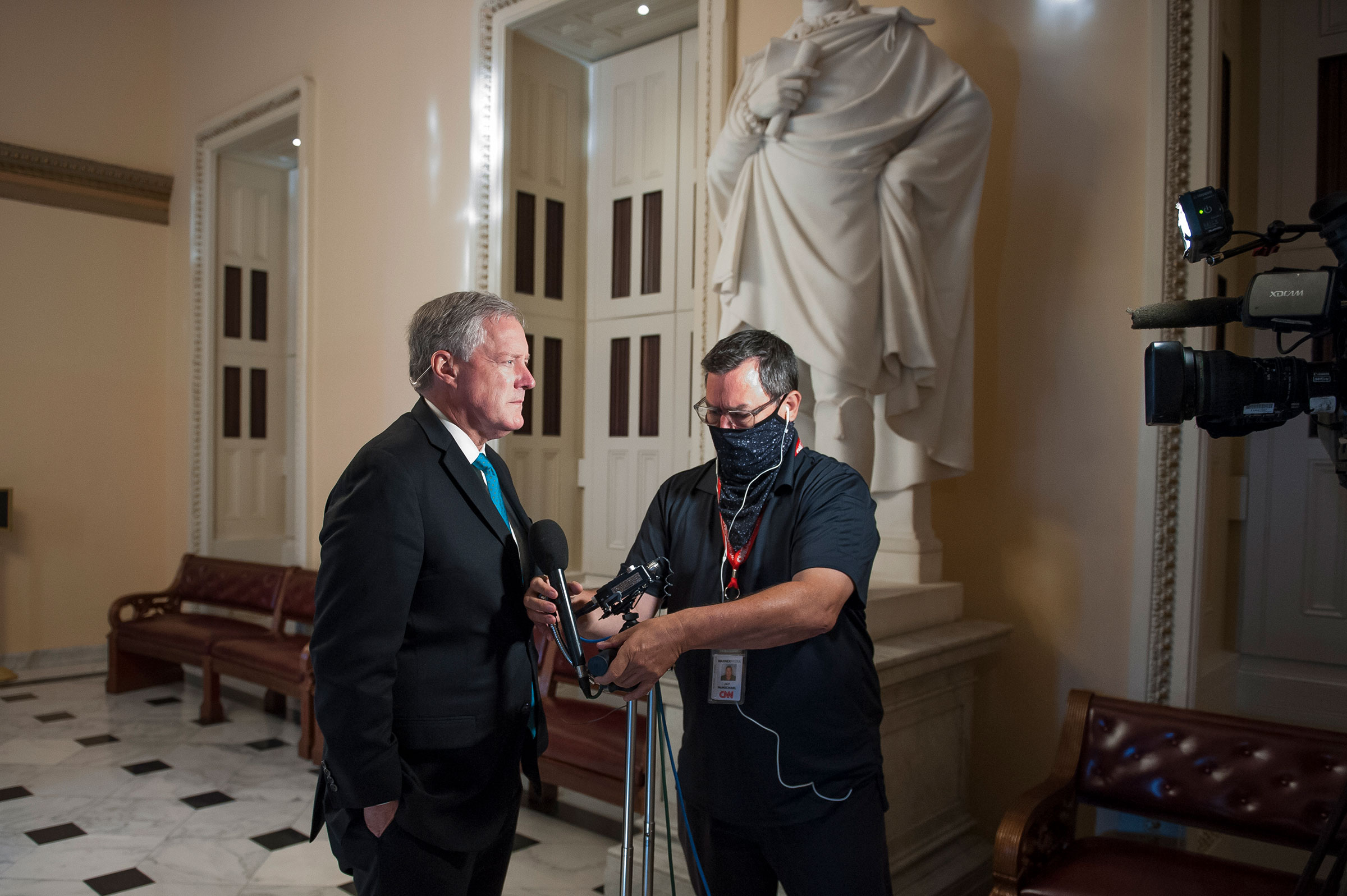 Assistant to the President and Chief of Staff Mark Meadows prepares to talk with reporters following a meeting with Speaker of the House Speaker Nancy Pelosi, Senate Minority Leader Chuck Schumer and Secretary of the Treasury Steven Mnuchin at the Capitol in Washington on Aug. 5, 2020.