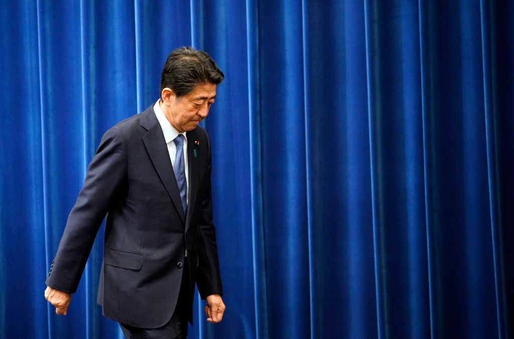 Japanese Prime Minister Shinzo Abe walks after delivering a press conference to announce his resignation at the prime minister's official residence in Tokyo, Japan on August 28, 2020.