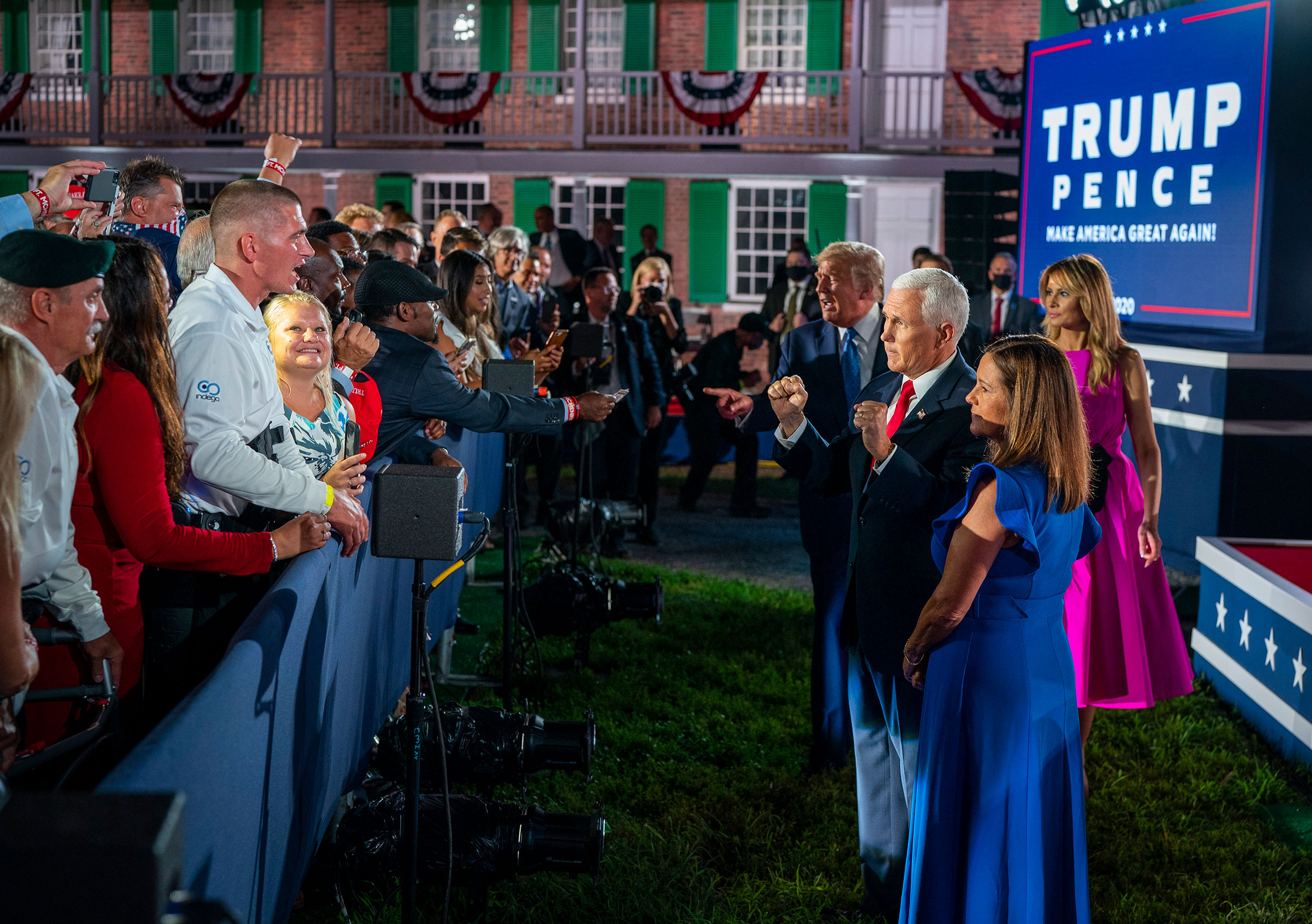 President Donald Trump and first lady Melania Trump, join Vice President Mike Pence and is wife, Karen Pence, while greeting attendees at Fort McHenry in Baltimore, during the Republican National Convention, Aug. 26, 2020.