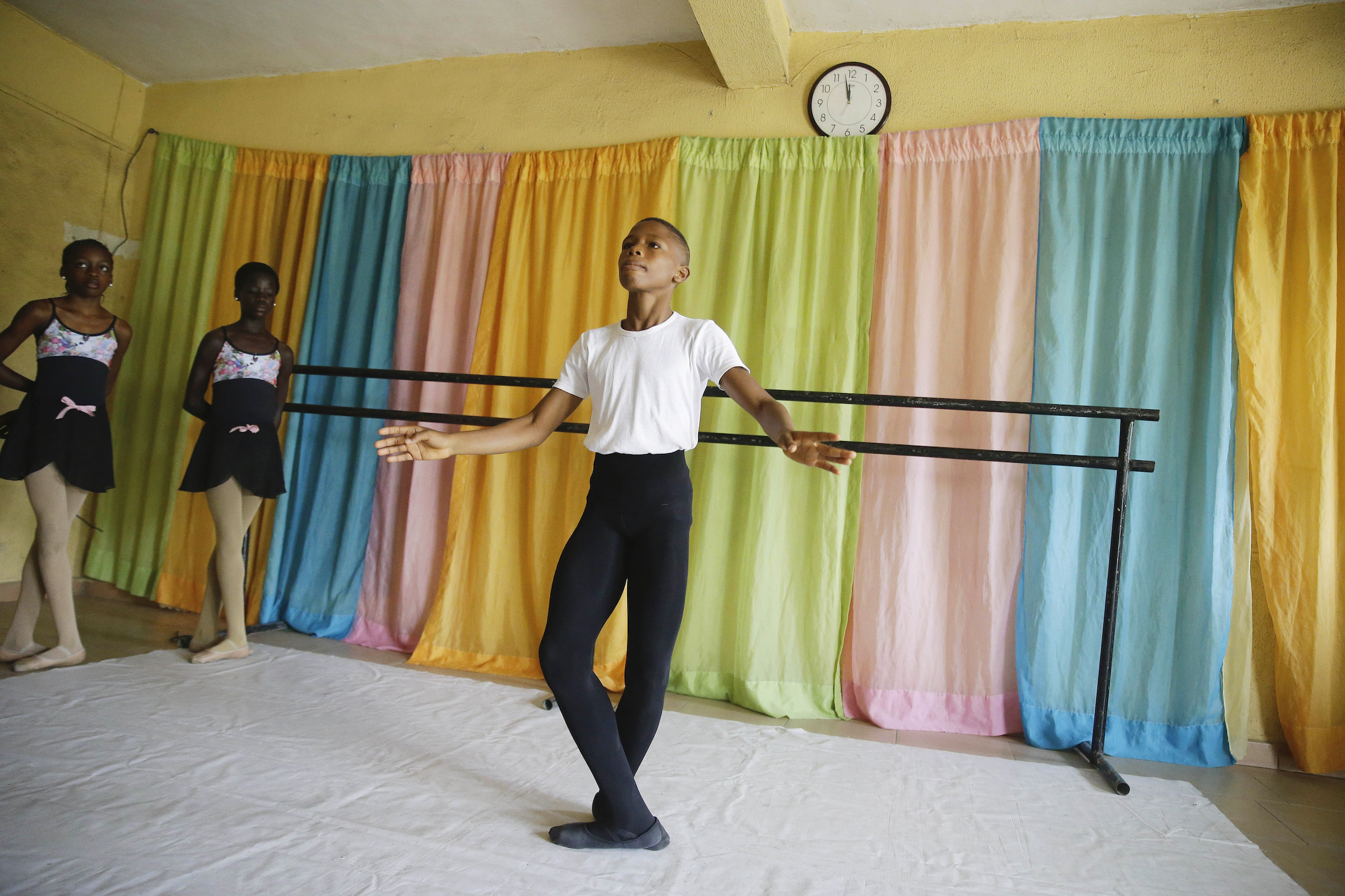 In this photo taken Tuesday, Aug. 18, 2020. Anthony Madu, a male ballet dancing  dance during a dancing rehearsal in Lagos Nigeria.