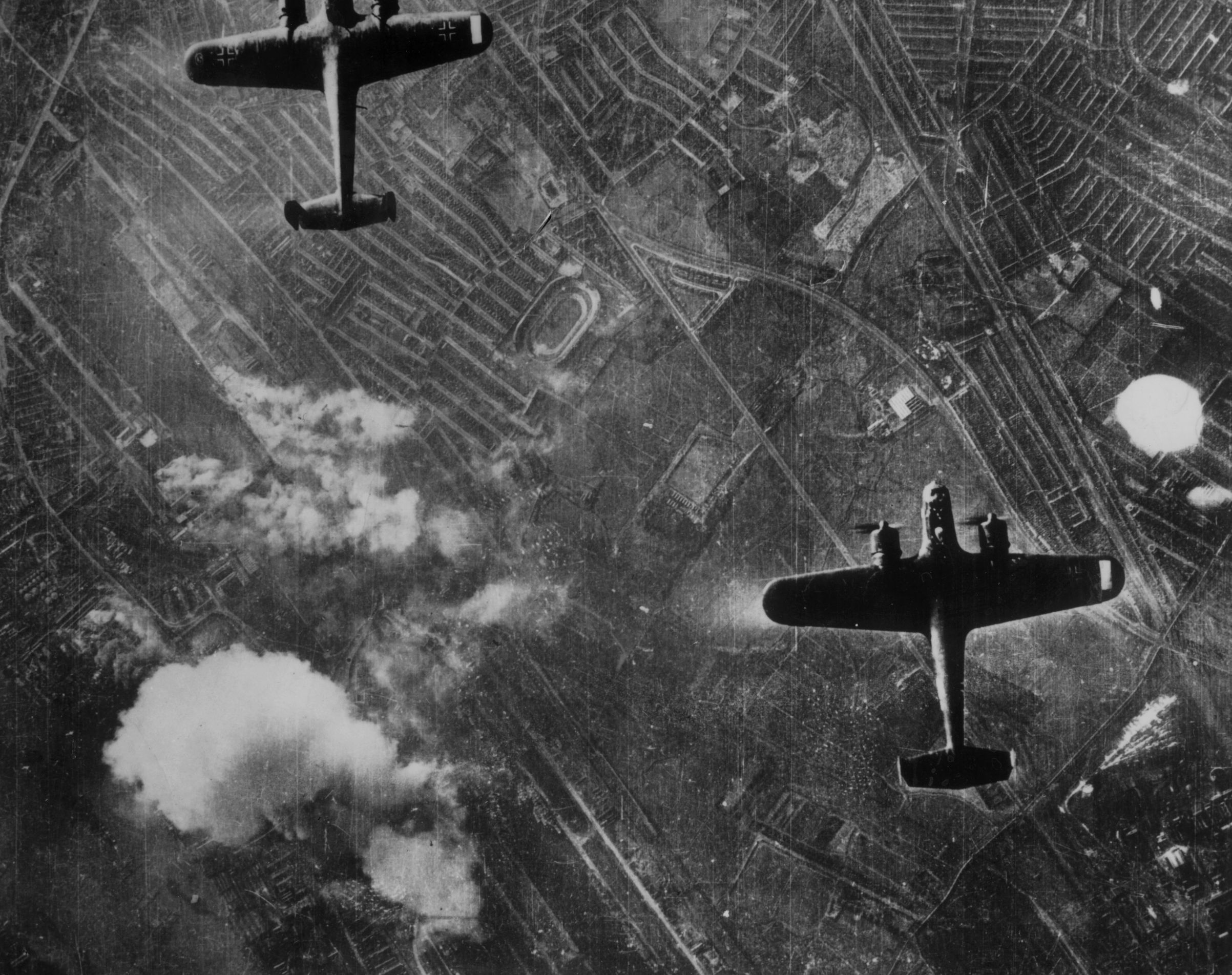 Two Luftwaffe Dornier 217 twin-engined medium bombers flying over the Silvertown area of London's Docklands on Sept. 7, 1940 at the beginning of the Blitz on London.