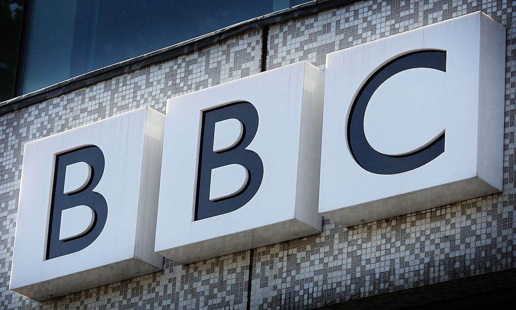 The BBC logo is displayed above the main entrance to Television Centre on October 18, 2007 in London, England.