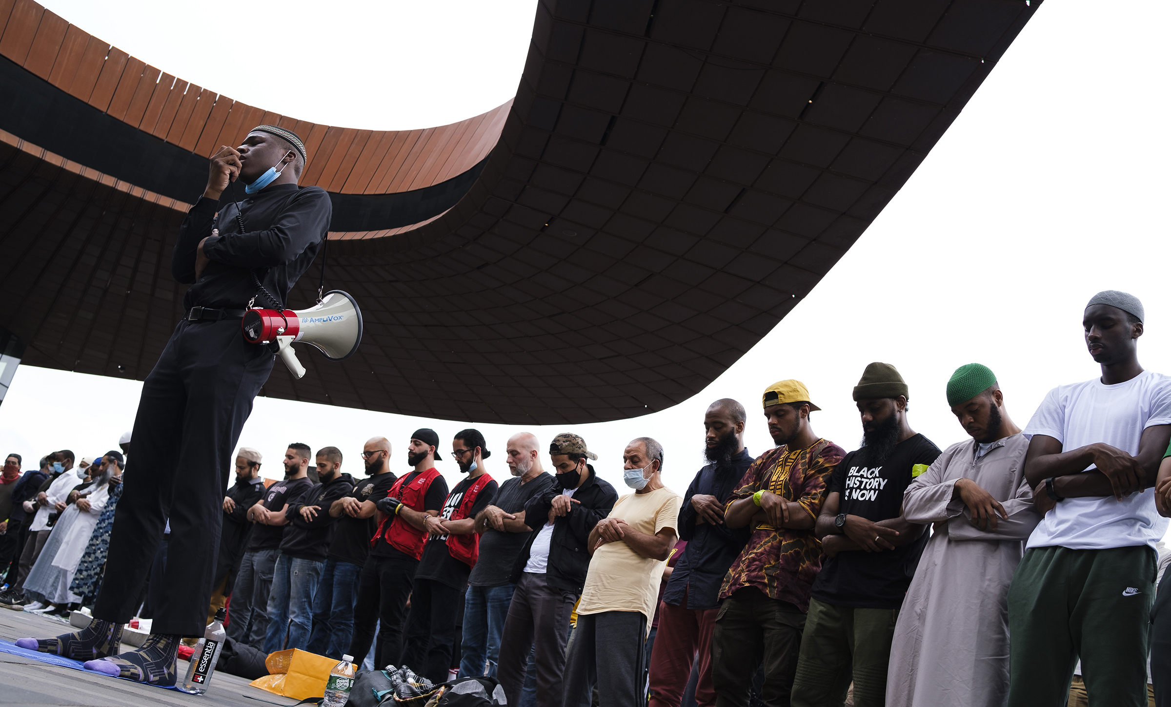 A group of Muslims gather for Friday prayers and Khutbah, and a subsequent Black Lives Matter march, outside of the Barclay's Center in Brooklyn, New York, June 5, 2020.