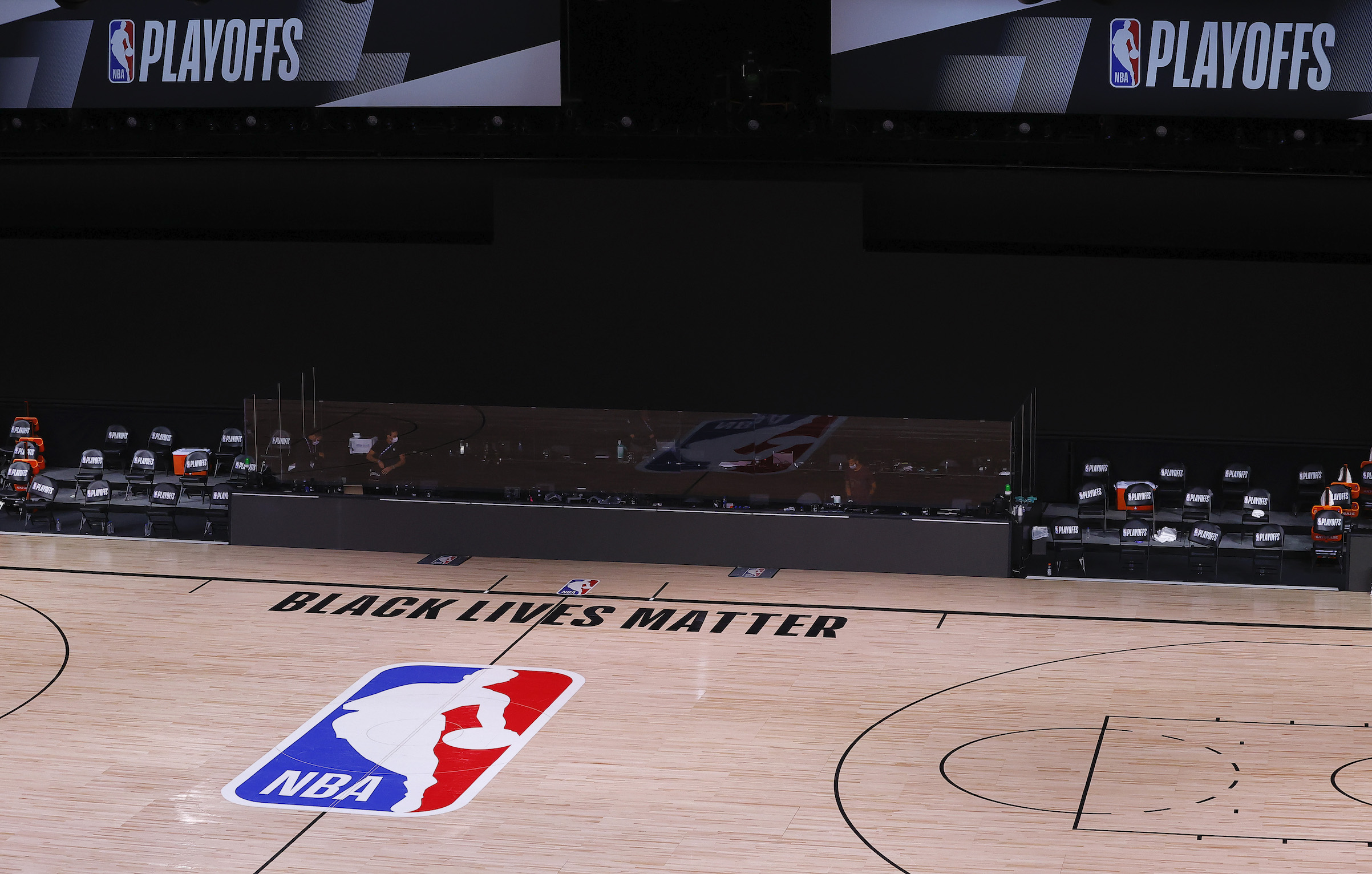 An empty court and bench is shown following the scheduled start time in Game Five of the Eastern Conference First Round between the Milwaukee Bucks and the Orlando Magic, on Aug. 26, 2020, in Lake Buena Vista, Fla.