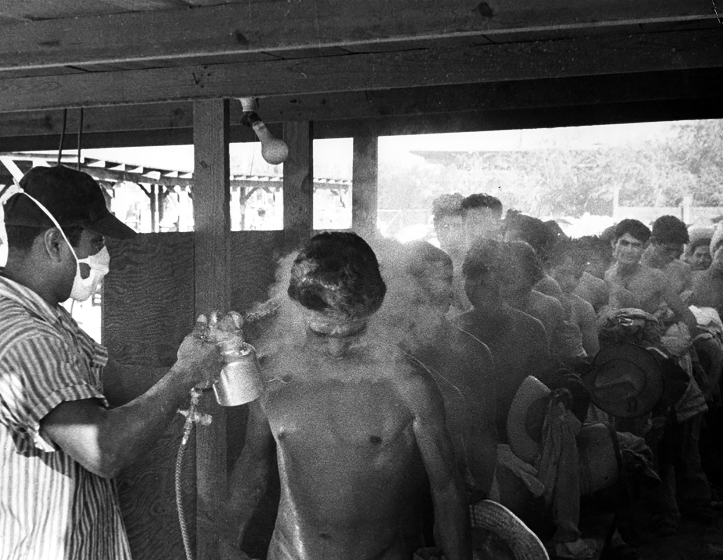 Contract Mexican laborers being fumigated with the pesticide DDT in Hidalgo, Texas in 1956.