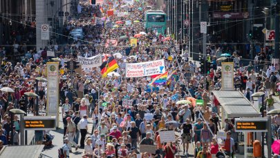 Thousands march along the 'Friedrichstrasse' during the demonstration against corona measures in Berlin, Germany, on Aug. 1, 2020.