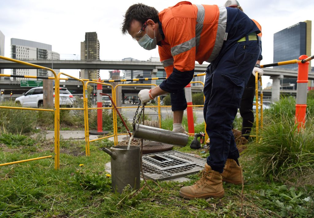 This photo taken on May 19, 2020 shows hydrographer Steven Paull taking samples from a sewer in Melbourne.