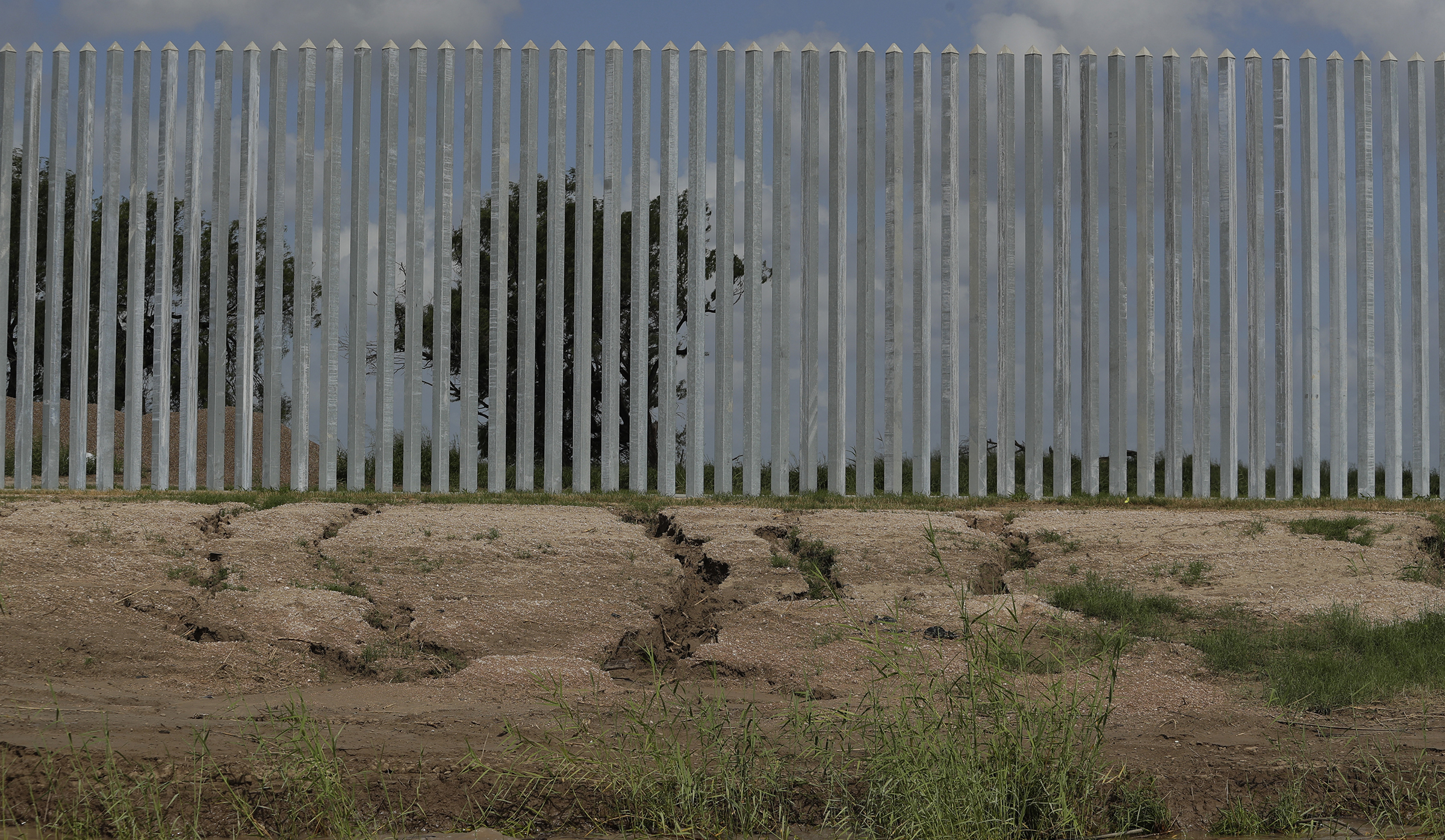 Erosion damage caused by Hurricane Hanna is seen along the Fisher border wall along the Rio Grande River near Mission, Texas, on July 30, 2020.
